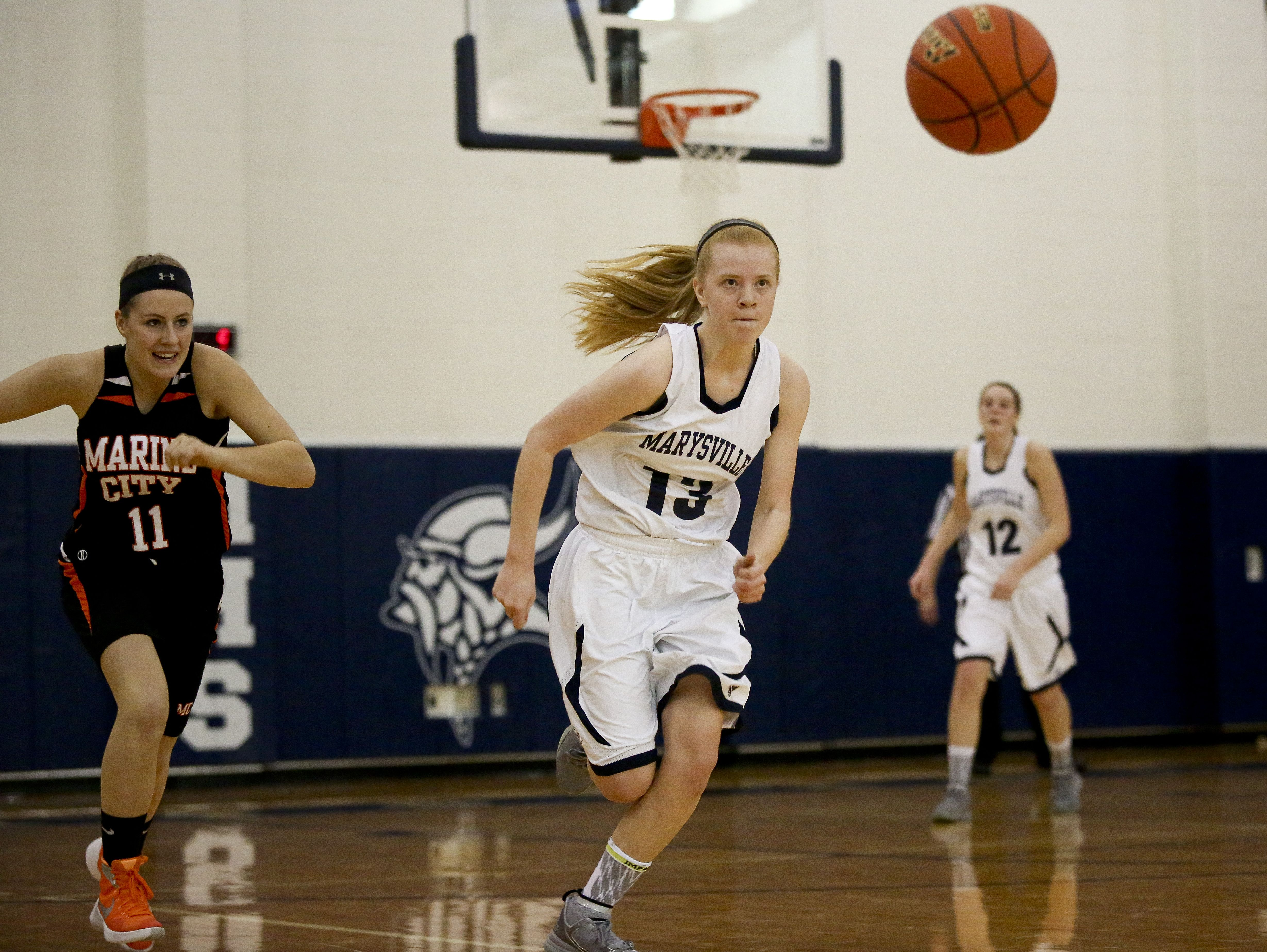 Marysville junior Kiara Kelley sprints for a loose ball during a basketball game Friday, Jan. 8, 2016 at Marysville High School.