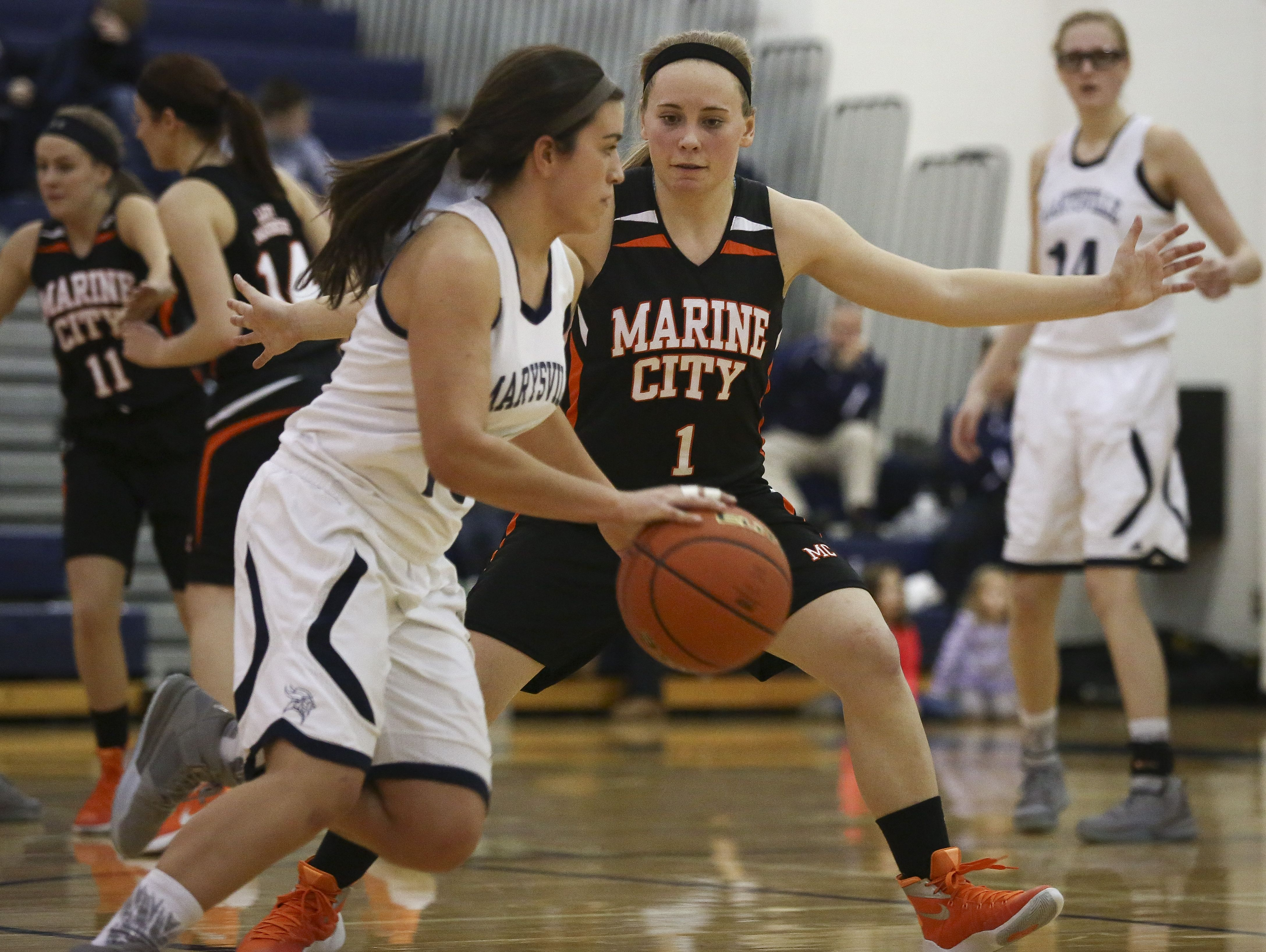 Marine City junior Antonia Potvin keeps pressure on Marysville junior Lydia Sawdon during a basketball game Friday, Jan. 8, 2016 at Marysville High School.