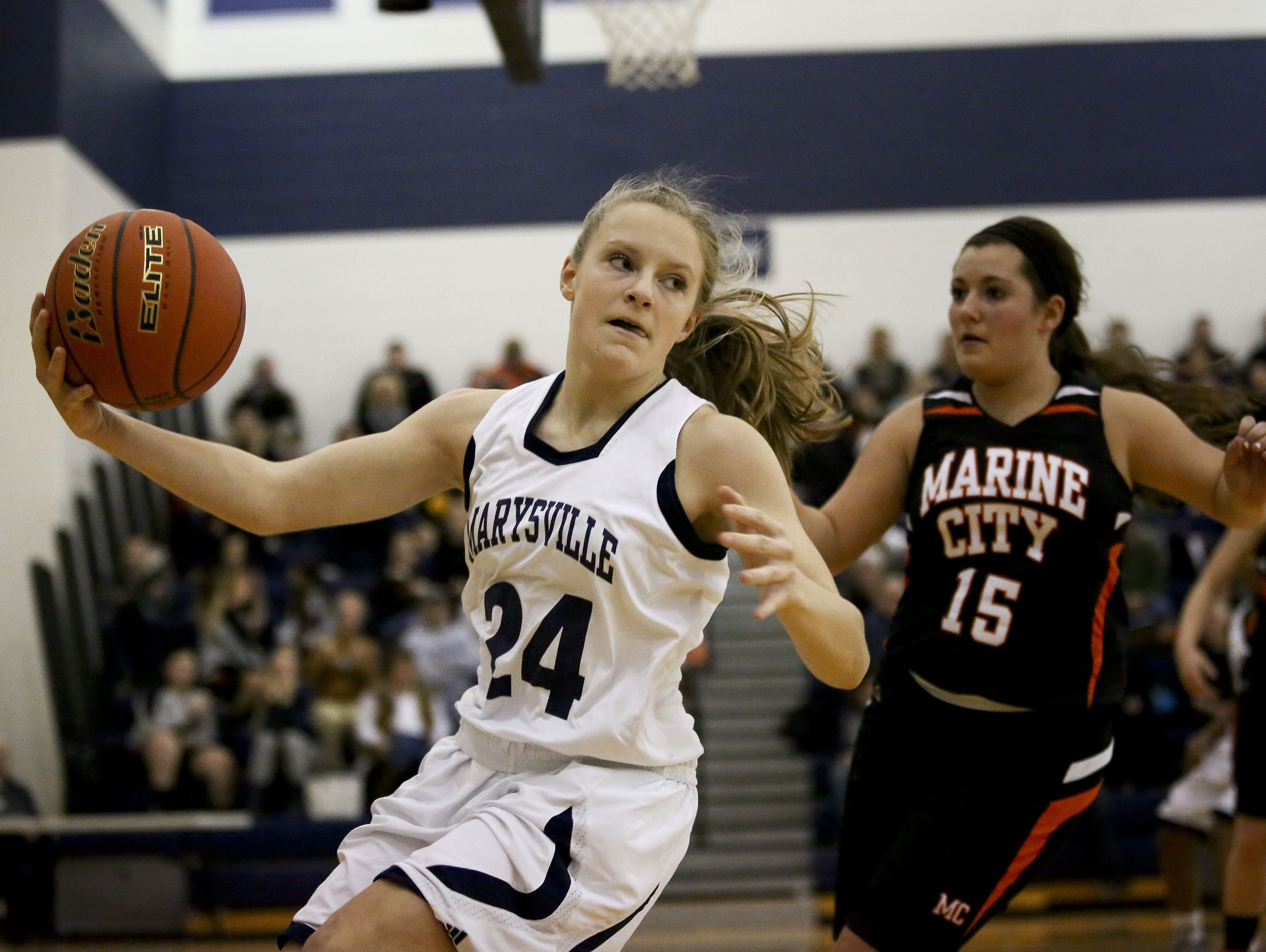 Marysville sophomore Hayley Delor keeps a loose ball in-bounds during a basketball game Friday, Jan. 8, 2016 at Marysville High School.