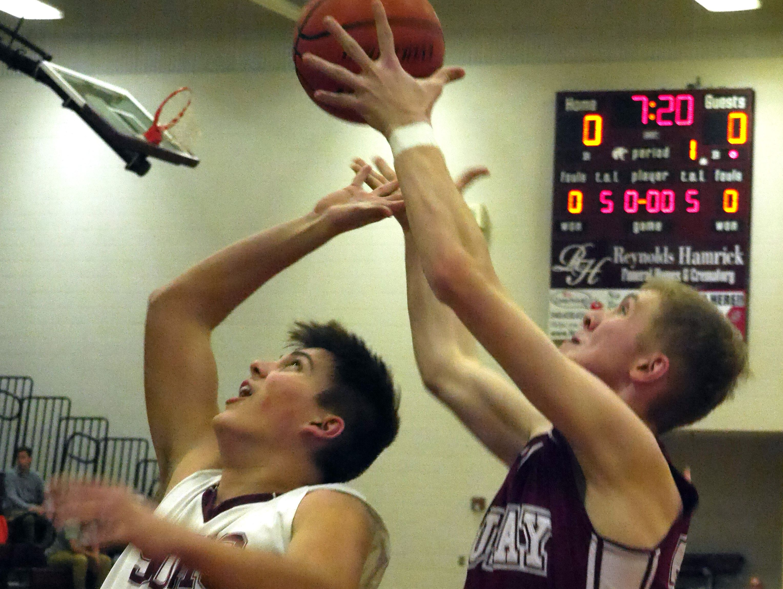 Stuarts Draft's #44, Taylor Reed battles Luray's #34 Josh Good in the early minutes of the first quarter during their boys basketball game Monday, Jan. 11, 2016