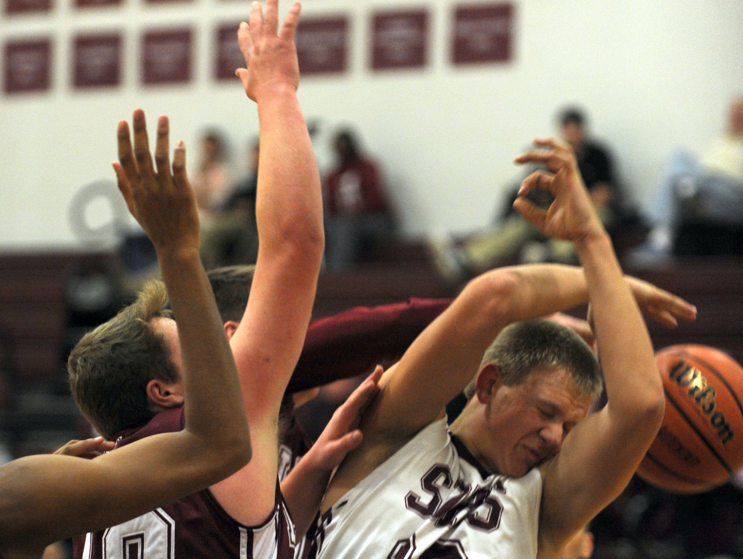 Stuarts Draft's #33, John Gumann is fouled while trying to pull in a rebound in the second quarter of their boys basketball game against Luray High School Monday, Jan. 11, 2016