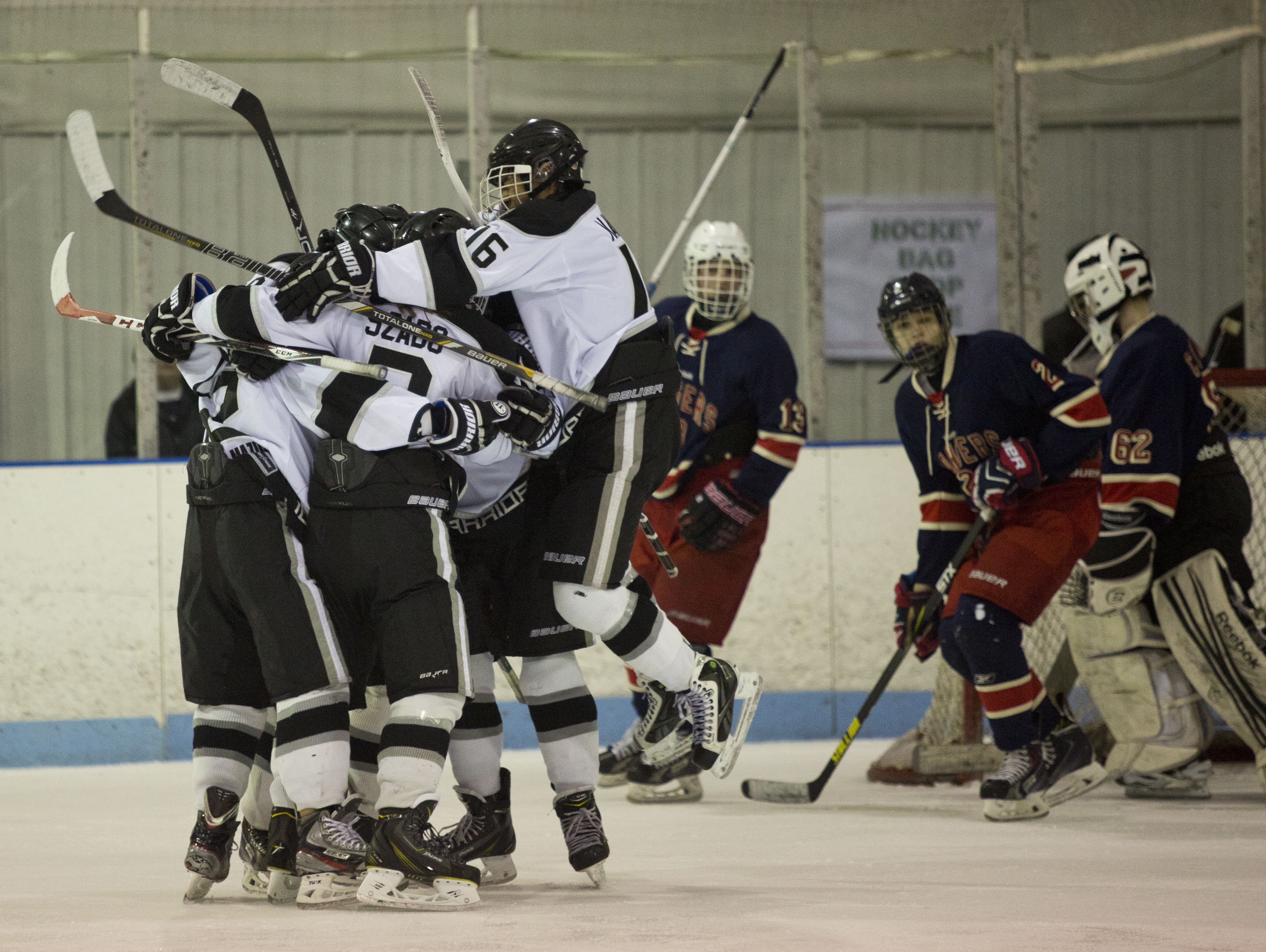 Mississauga Ice Warriors celebrate scoring a goal during a Silver Stick Bantam AA hockey game Saturday at Glacier Pointe in Port Huron Township. JEFFREY M. SMITH/TIMES HERALD.
