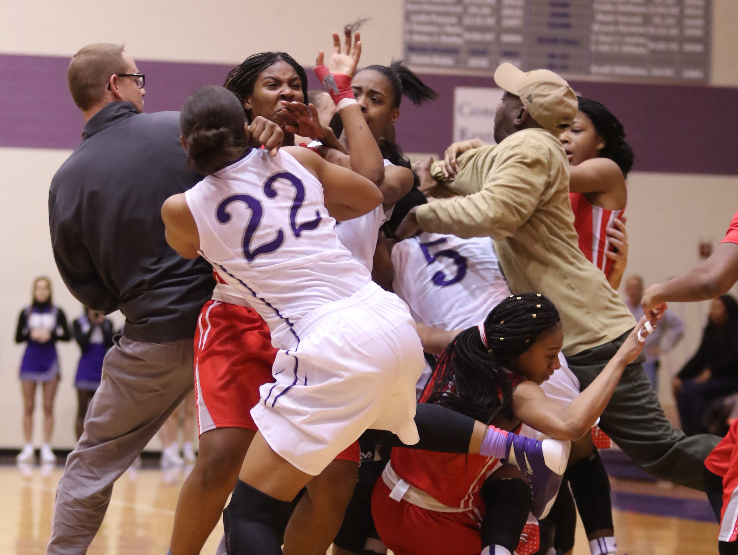 Players from Ben Davis and Pike fight in the fourth quarter of the game as fans and players spilled on to the court. (Photo: Indianapolis Star)