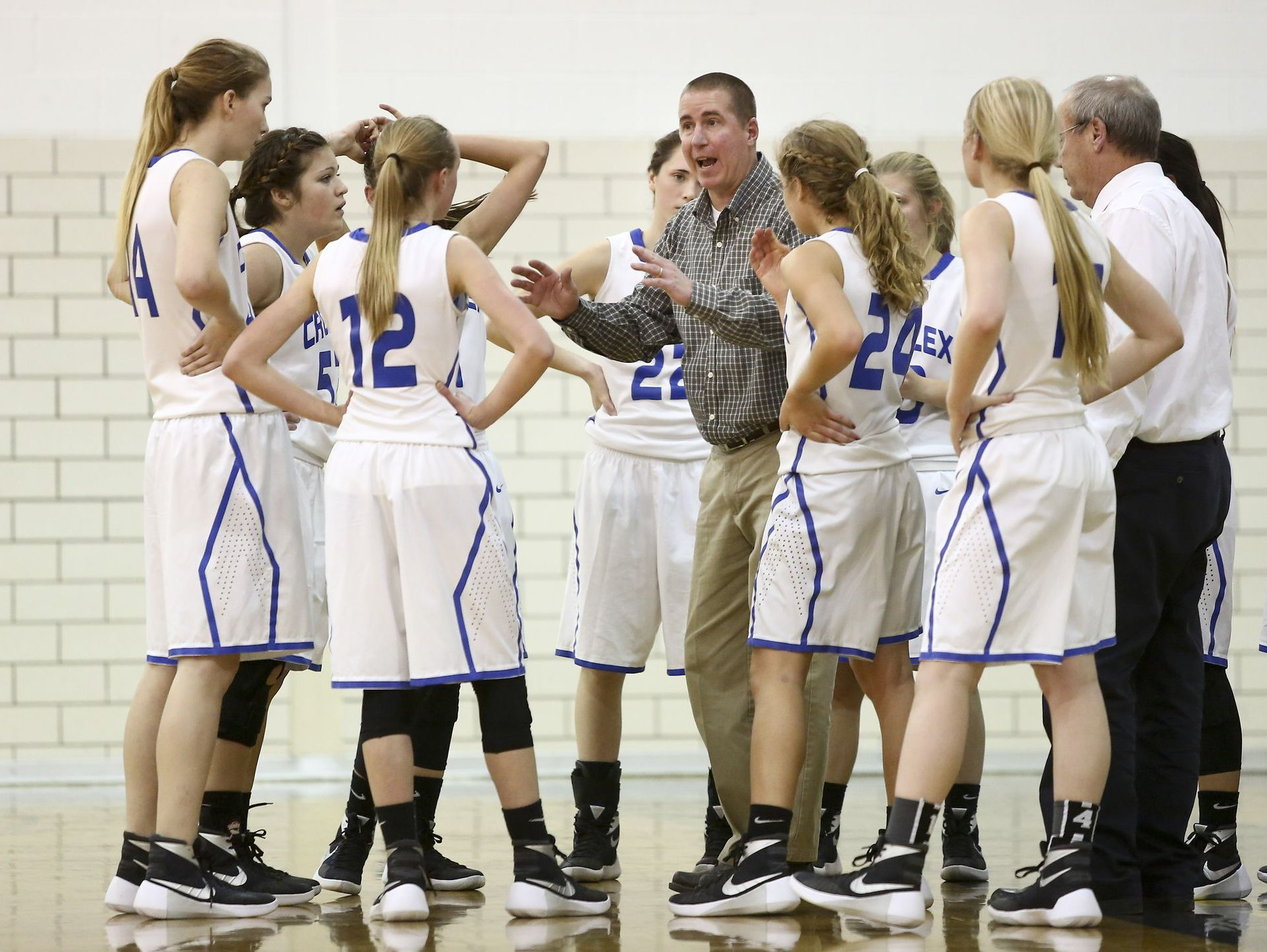 Cros-Lex coach Darren Bongard talks with players in a huddle during the Holiday Girls Basketball Tournament Tuesday, Dec. 22, 2015 at Port Huron Northern High School.