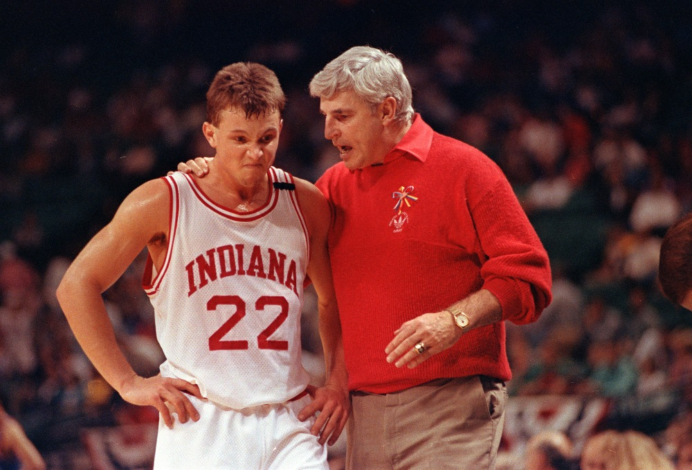 Damon Bailey (22) of Indiana University listens to coach Bobby Knight during Indiana's loss to Kansas in NCAA Southeast Regional action in Charlotte, N.C., Thursday night, March 22, 1991. Baily had 20 points, but Kansas beat Indiana 83-65 to eliminate the Hoosiers from the NCAA tournament. (AP Photo/Chuck Burton)