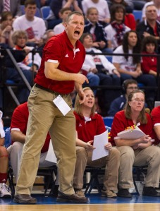 Bedford North Lawrence High School head coach Damon Bailey encourages his team on the court during the first half of the IHSAA Girls Basketball Class 4A Championships, Saturday, March 8, 2014, in Terre Haute, Ind. (AP Photo/Doug McSchooler)