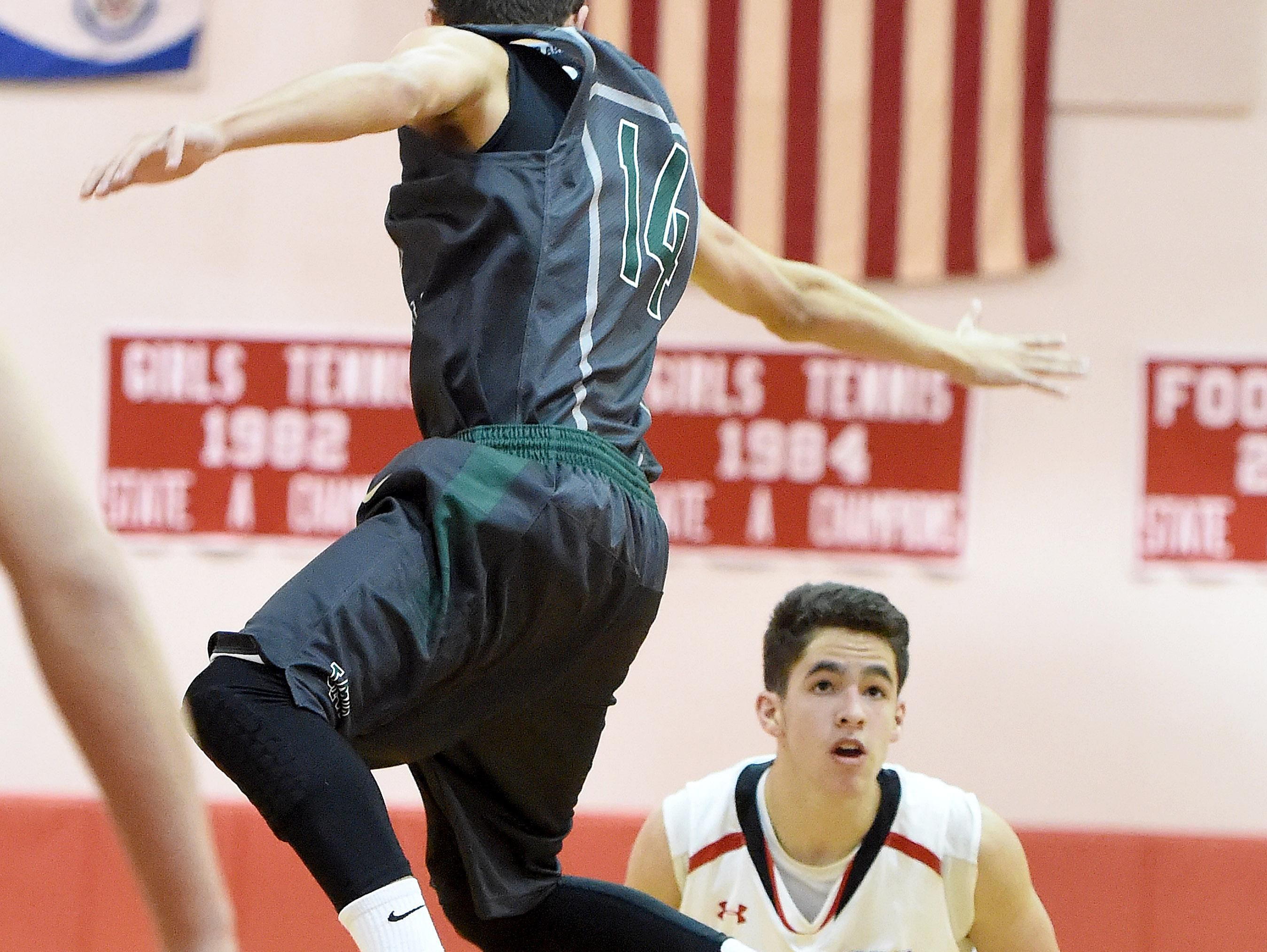 Riverheads' Bradley Roberts looks to shoot as Wilson Memorial's Ryan Pierce goes high during a basketball game played in Greenville on Friday.
