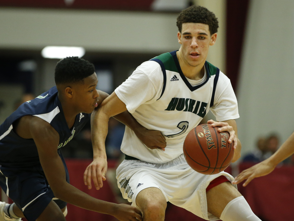 Jan 18, 2016 -- Springfield, MA, U.S.A -- Chino Hills Lonzo Ball (2) works the ball against High Point Christian Jalen Cone (1) in the second half of the Spalding Hoophall Classic at Blake Arena in Springfield, Mass. Chino Hills defeated High Point Christian 100-75. -- Photo by David Butler II-USA Today Sports Images ORG XMIT: US 134344 Spalding Hoophal 1/17/2016 [Via MerlinFTP Drop]