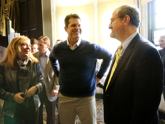 Michigan football coach Jim Harbaugh, center, talks with U-M president Mark Schlissel, right, after a news conference in Ann Arbor. (Photo: Kimberly P. Mitchell, Detroit Free Press)