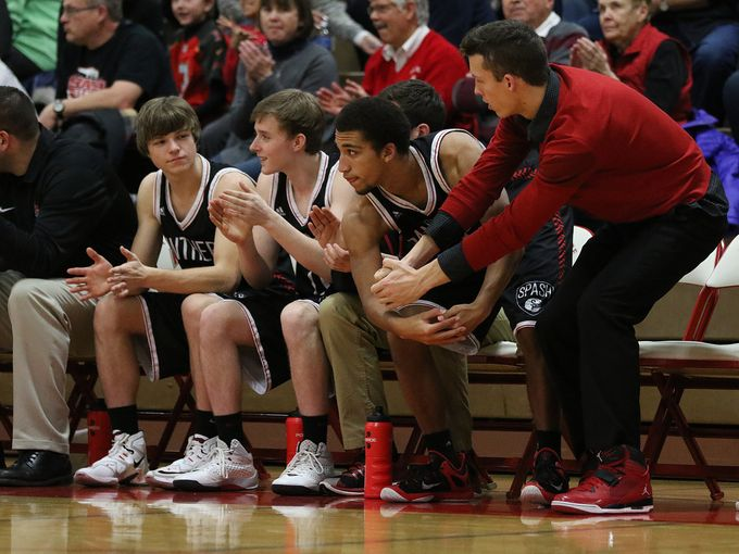 The Stevens Point Area Senior High School bench reacts to a Sam Hauser three-pointer during the first half of a 92-42 win at Lincoln (Wisconsin Rapids) on Friday. (Photo: Megan McCormick/Stevens Point Journal Media).
