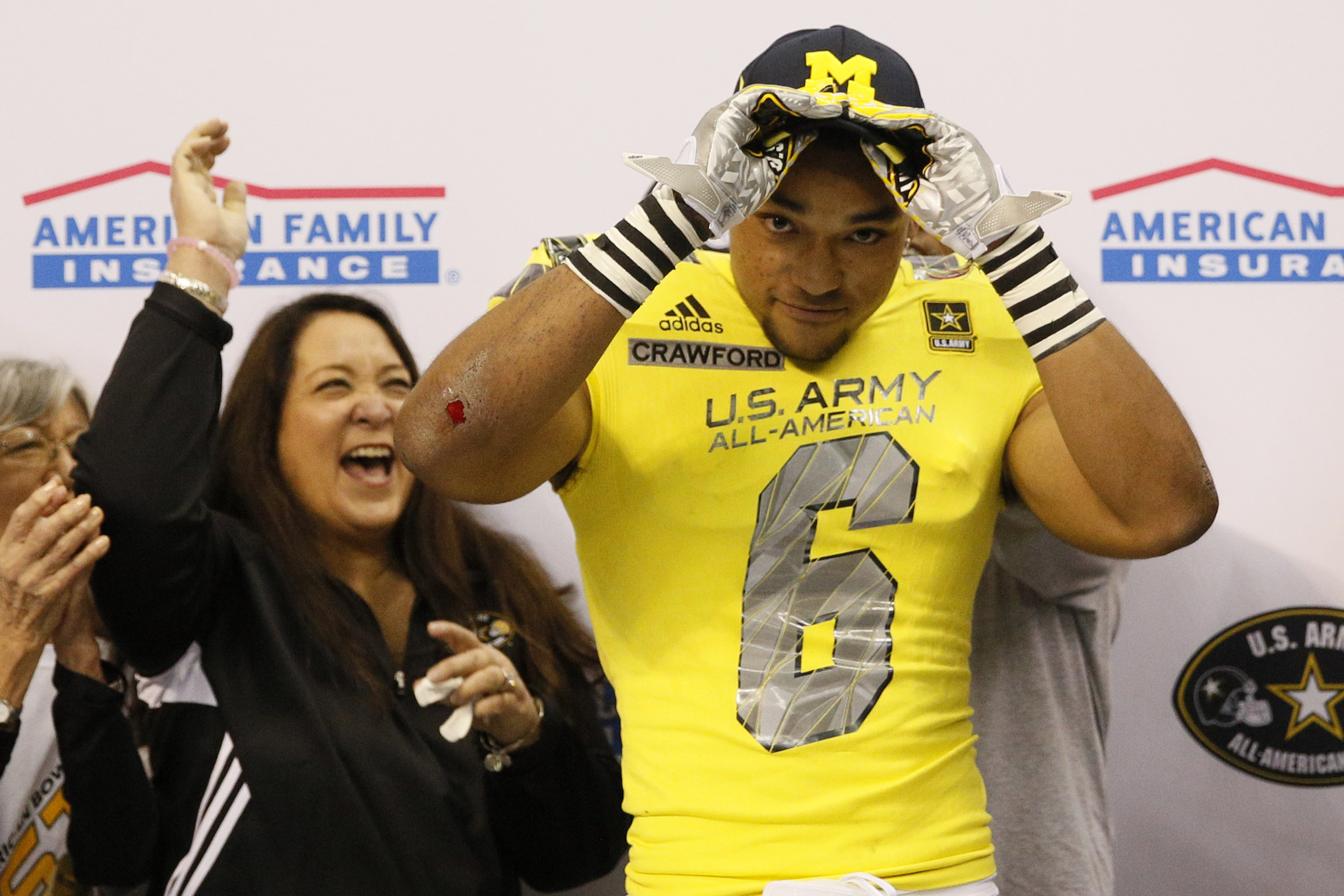 Wide receiver Dylan Crawford (6) shows off his University of Michigan hat after committing (Photo: Soobum Im, USA TODAY Sports)