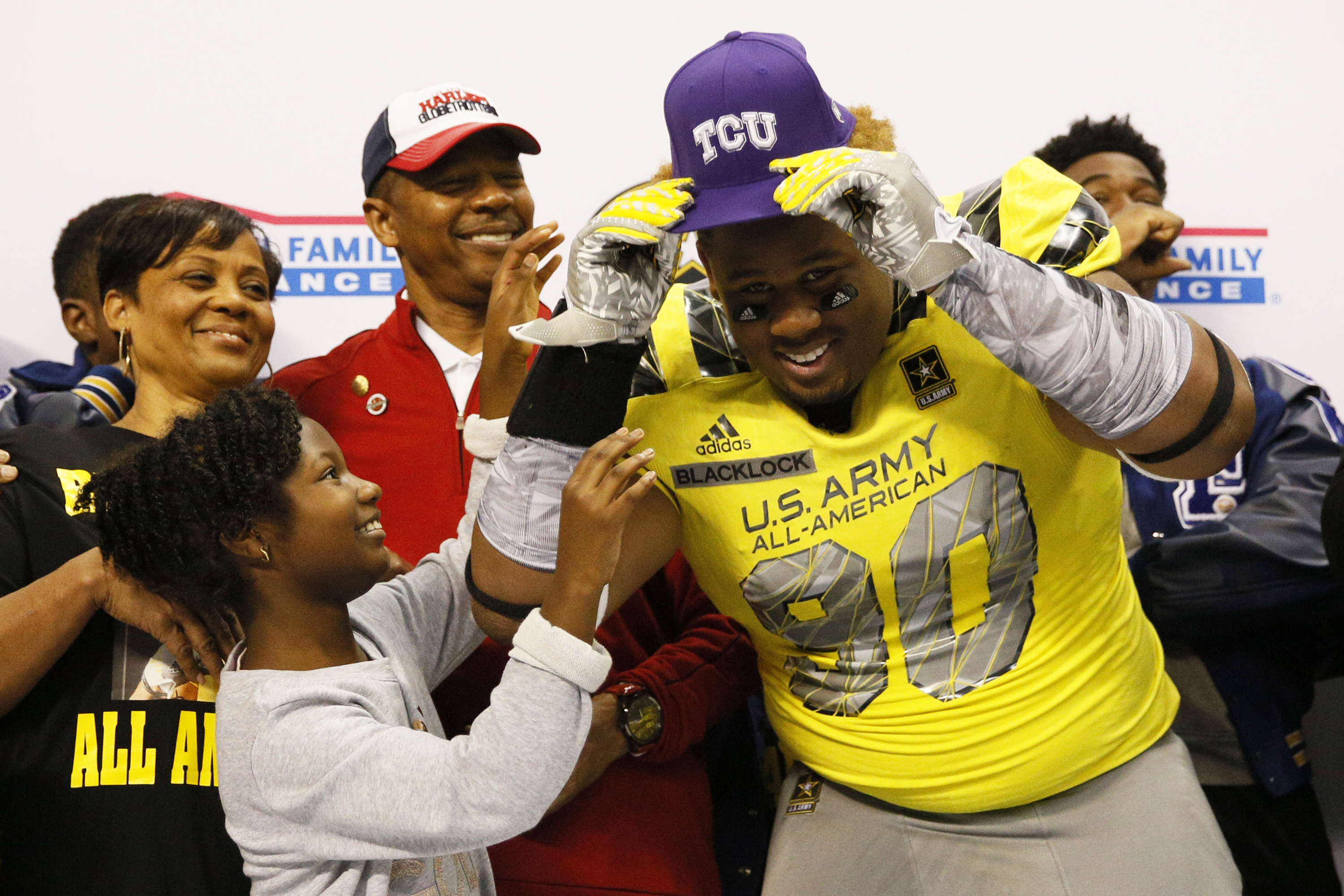 West defensive lineman Ross Blacklock (90) shows off his Texas Christian University hat after committing  (Photo: Soobum Im, USA TODAY Sports)