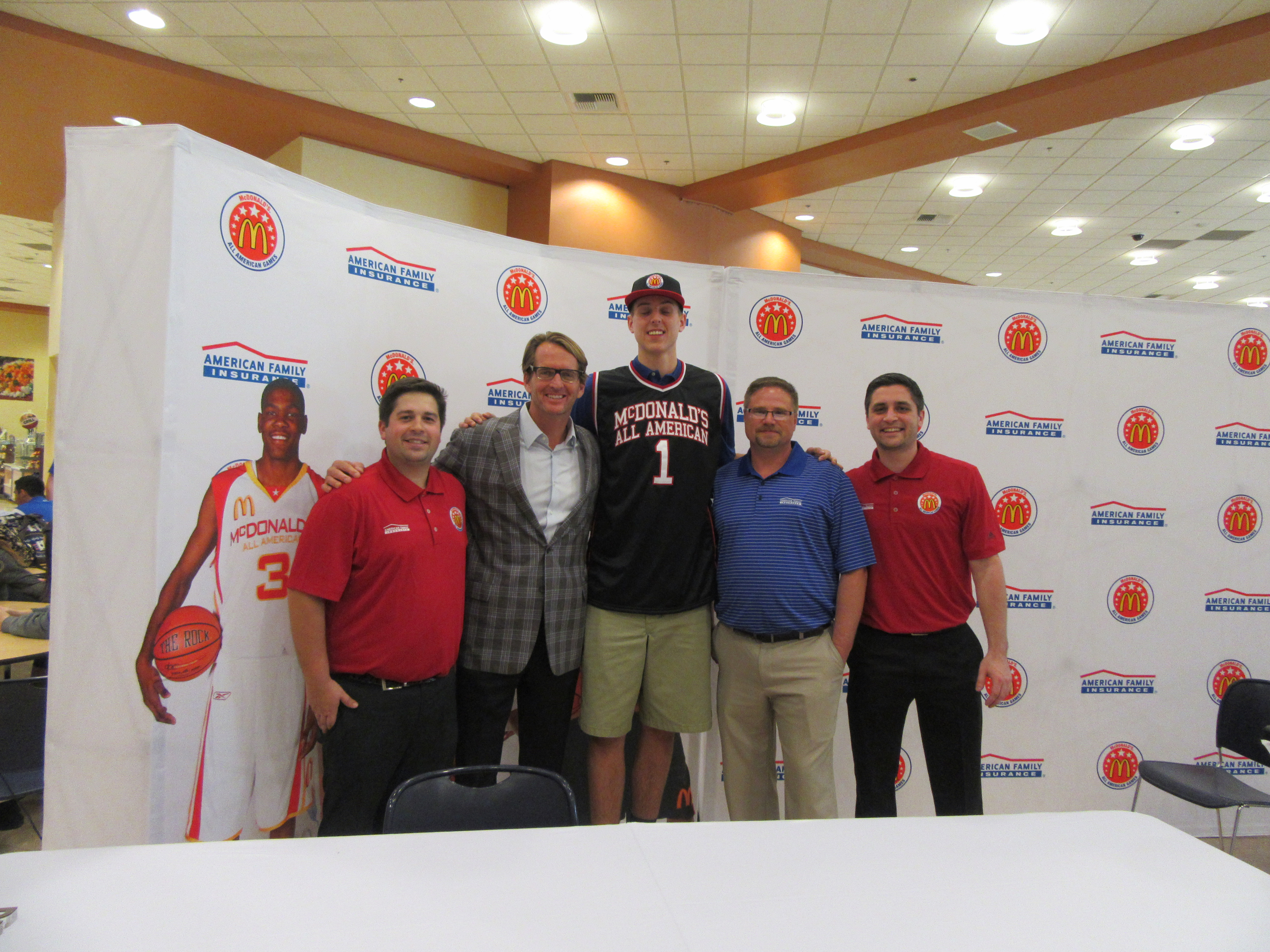 Zach Collins poses with representatives from American Family Insurance and McDonald's (Photo: McDonald's All American Game)