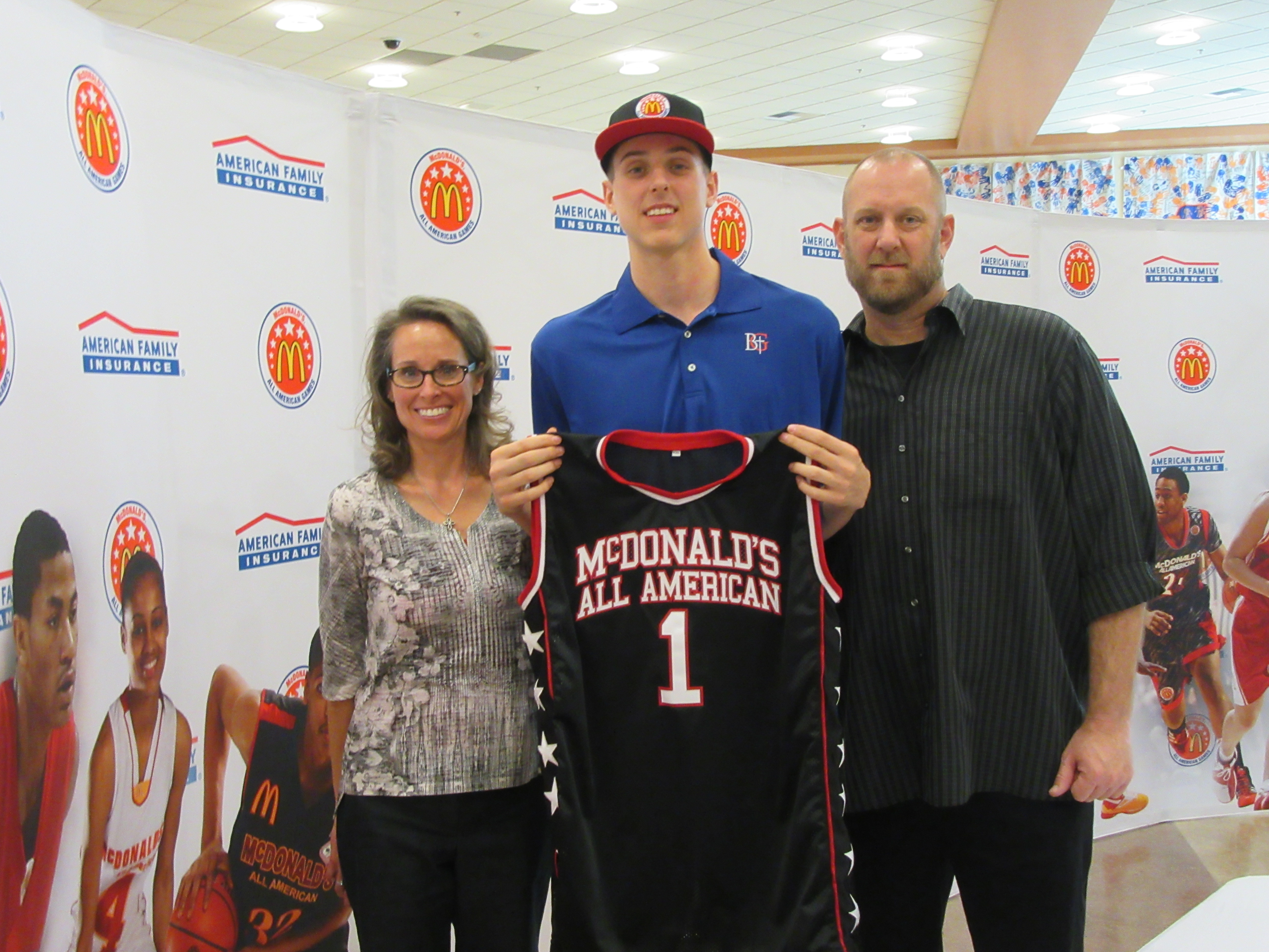 Zach Collins poses with his parents after receiving his McDonald's All American jersey (Photo: McDonald's All American Game)