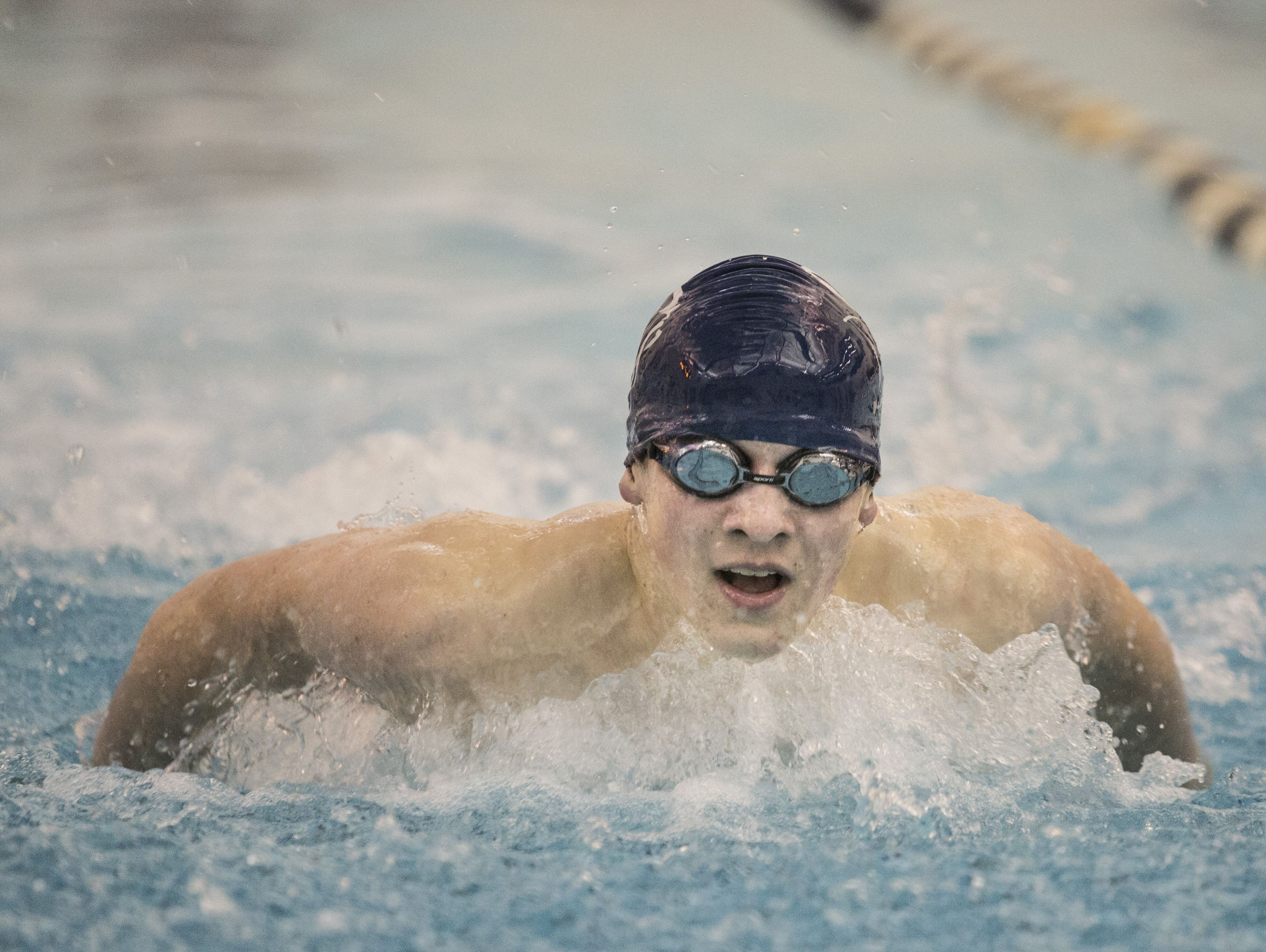 Marysville's Jeremy Latham competes in the 100 yard butterfly during a swim meet Tuesday, Feb. 9, 2016 at Marysville High School.