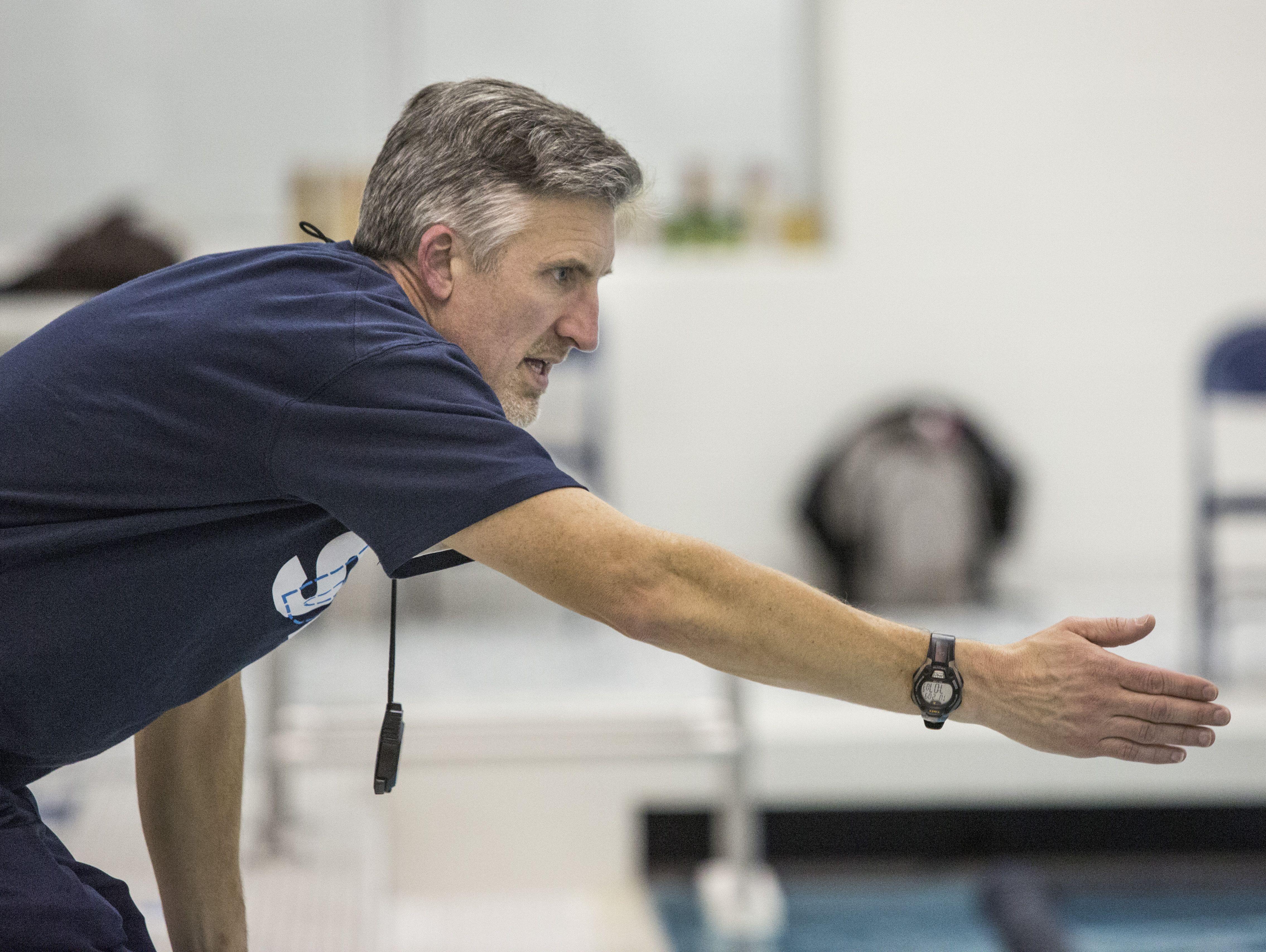 Marysville coach Steve Rogers yells to swimmer during a swim meet Tuesday, Feb. 9, 2016 at Marysville High School.