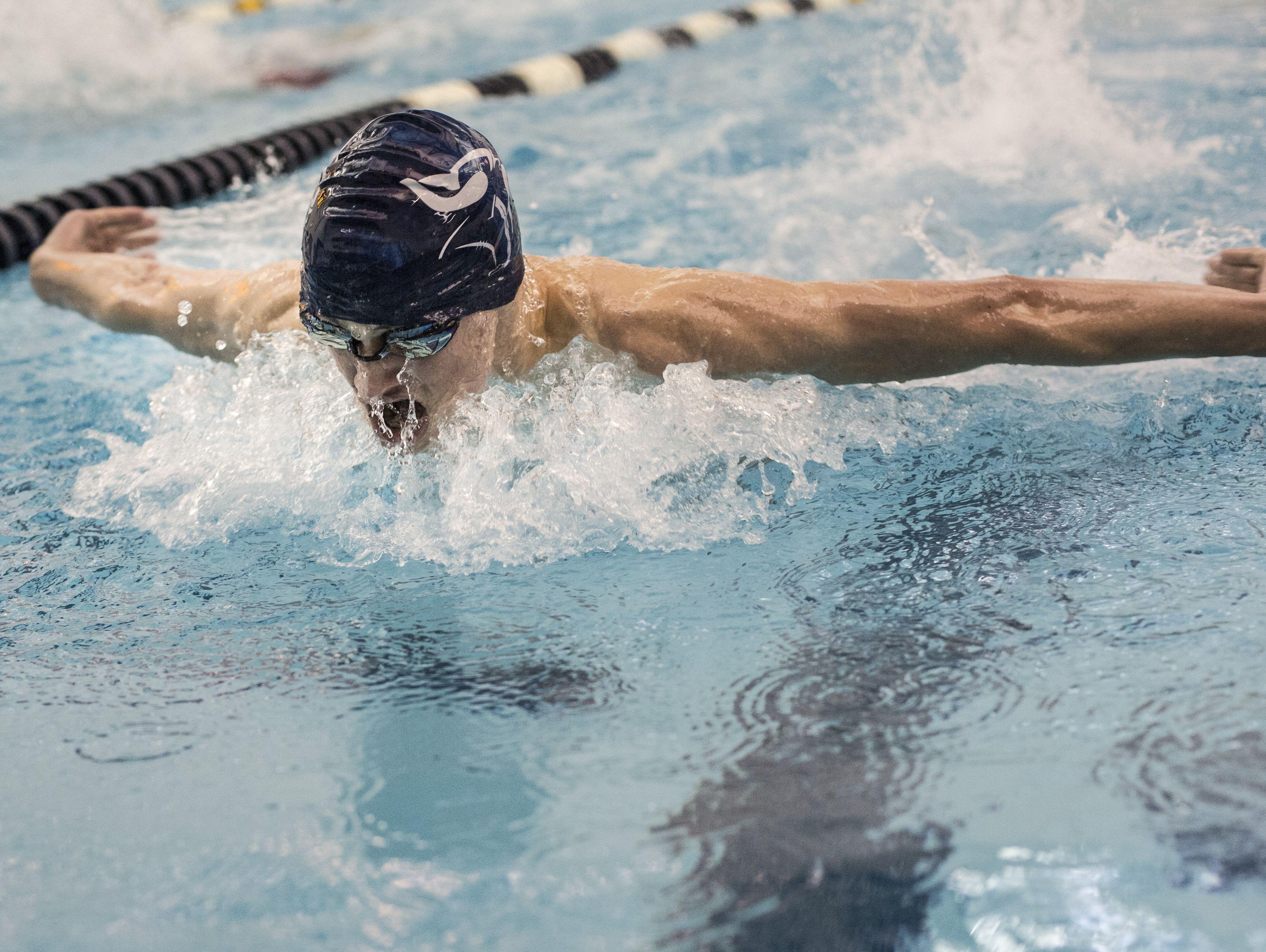 Marysville's Derek Wilson competes in the 200 yard IM during a swim meet Tuesday, Feb. 9, 2016 at Marysville High School.