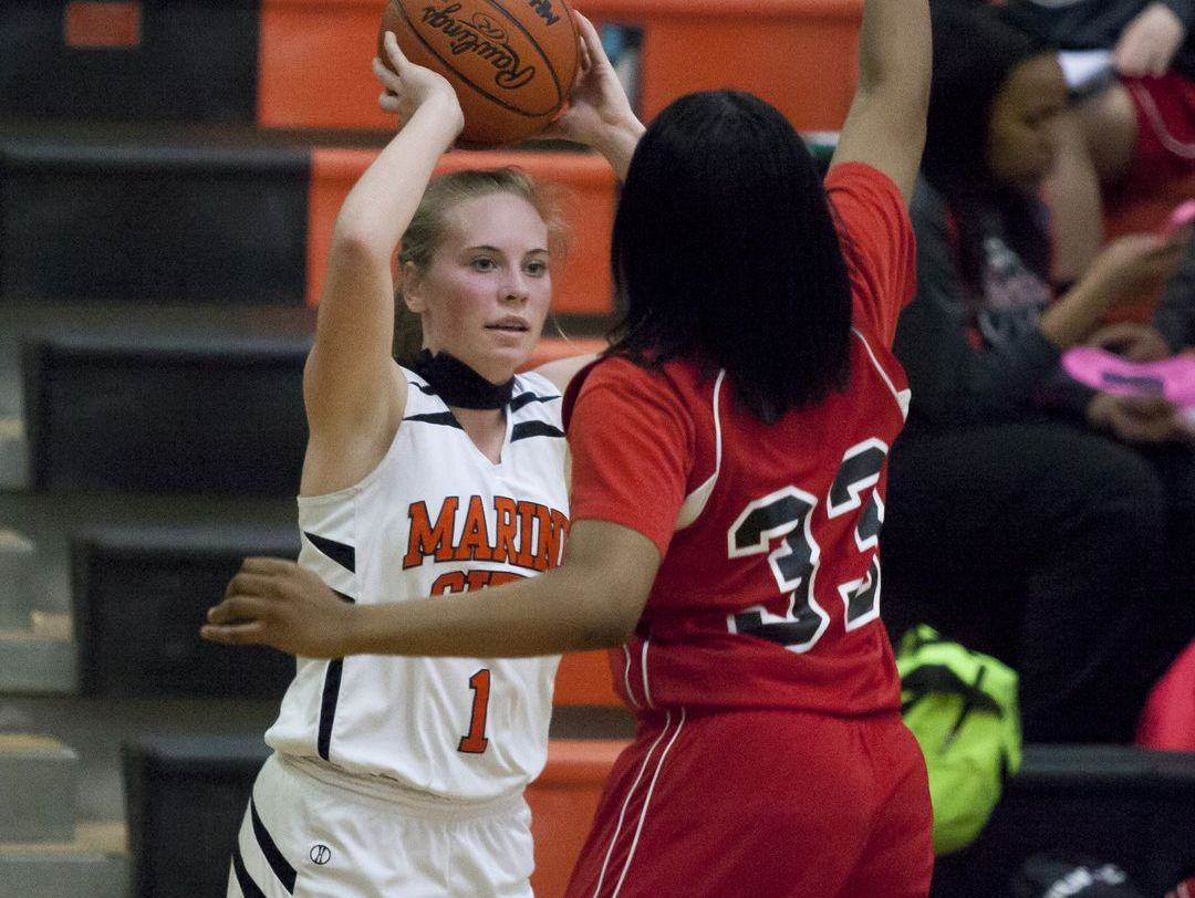 Marine City junior Antonia Potvin looks to pass during a basketball game Thursday, Jan. 14, 2016 at Marine City High School.