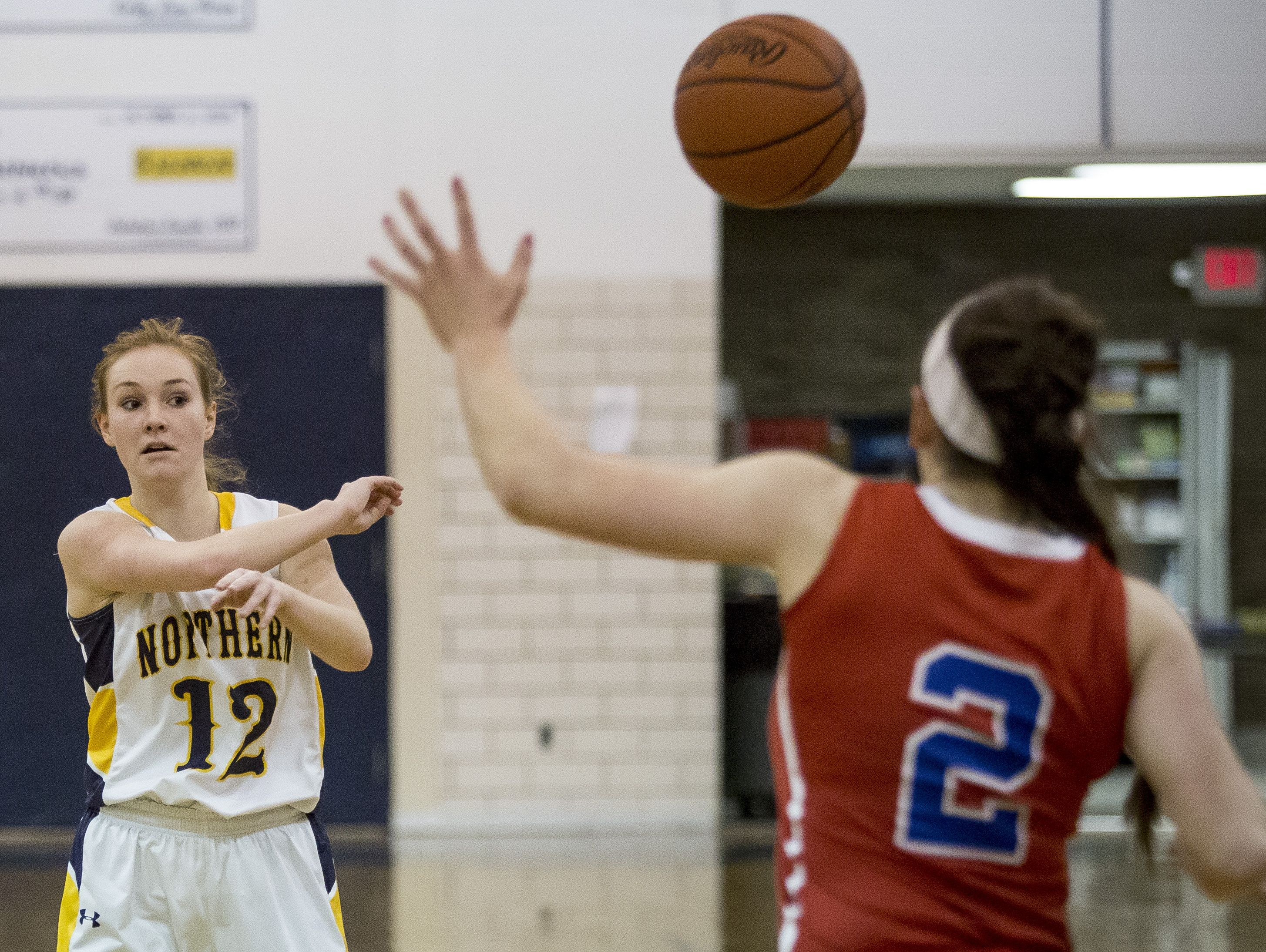 Port Huron Northern junior Kathleen O'Connor passes the ball during a basketball game Friday, Feb. 19, 2016 at Port Huron Northern High School.