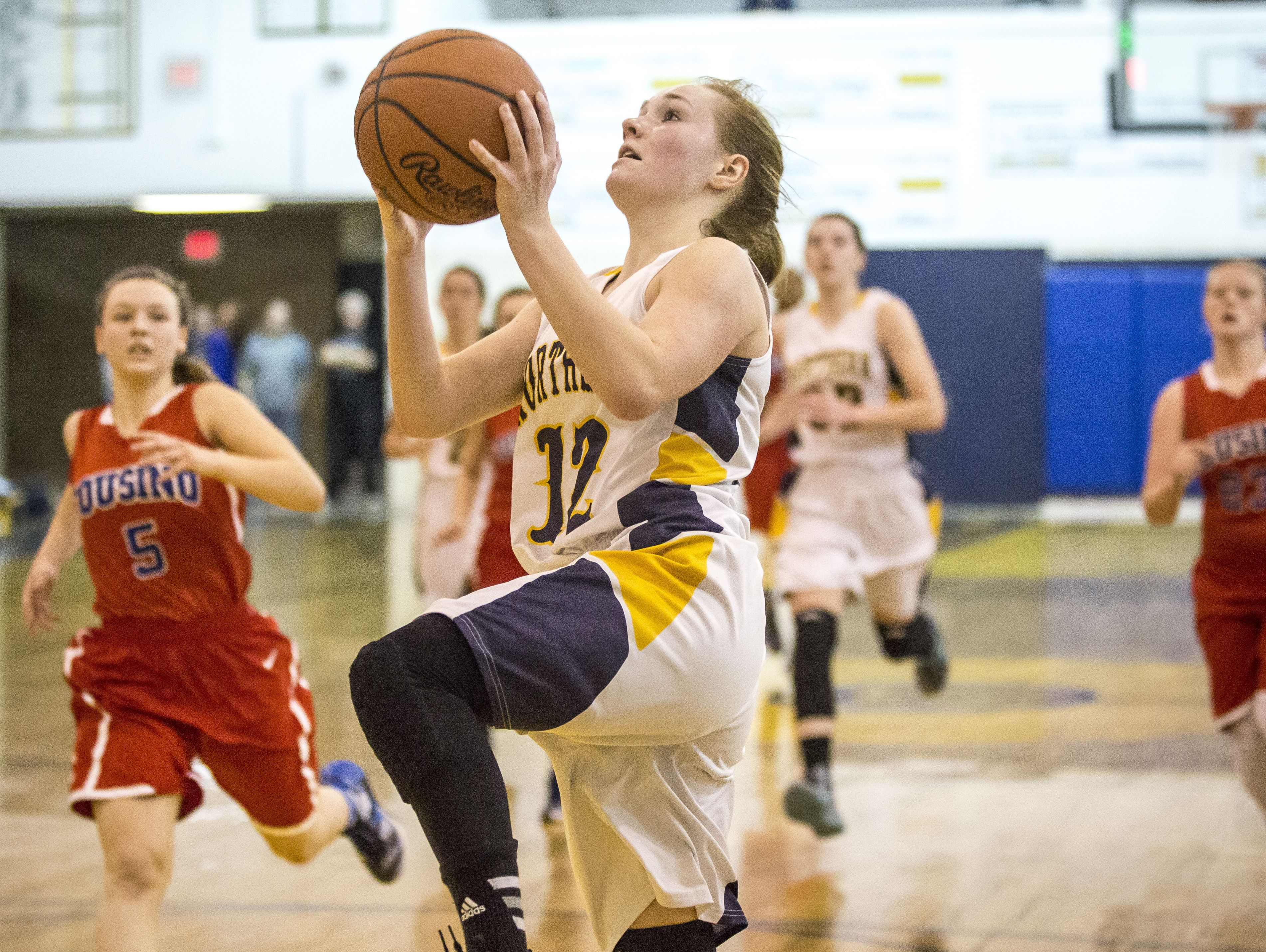 Port Huron Northern junior Kathleen O'Connor goes for a layup during a basketball game Friday, Feb. 19, 2016 at Port Huron Northern High School.