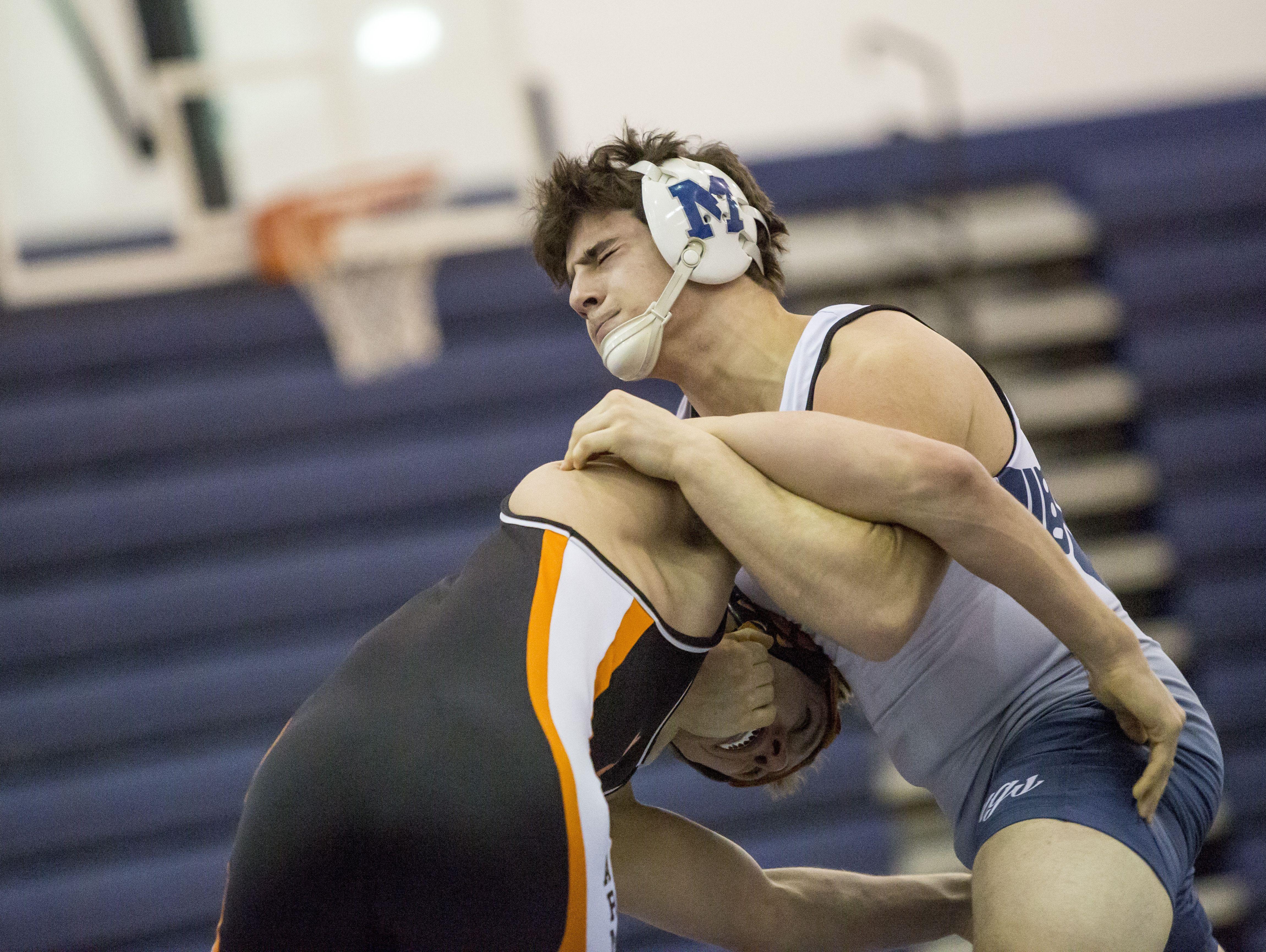 Marysville's Dante Chrcek wrestles Armada's Trent Grabowski during a wrestling meet Wednesday, Feb. 10, 2016 at Marysville High School.