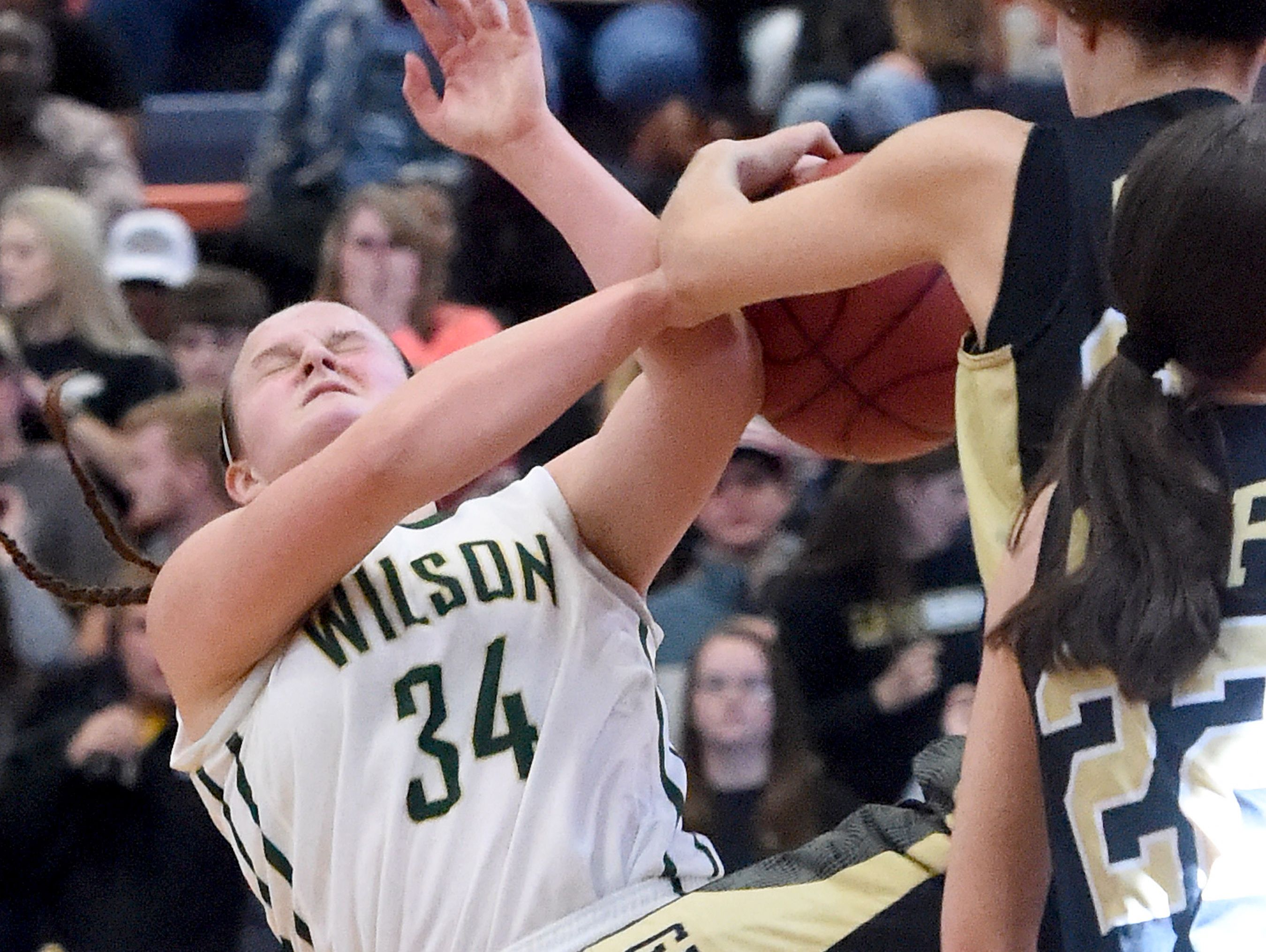 Wilson Memorial's Cheridan Hatfield looses the ball as she tries to take it up to the basket as it is stripped away by Buffalo Gap's Destiny Harper during the Region 2A East girls basketball championship played in Orange on Saturday, Feb. 27, 2016.
