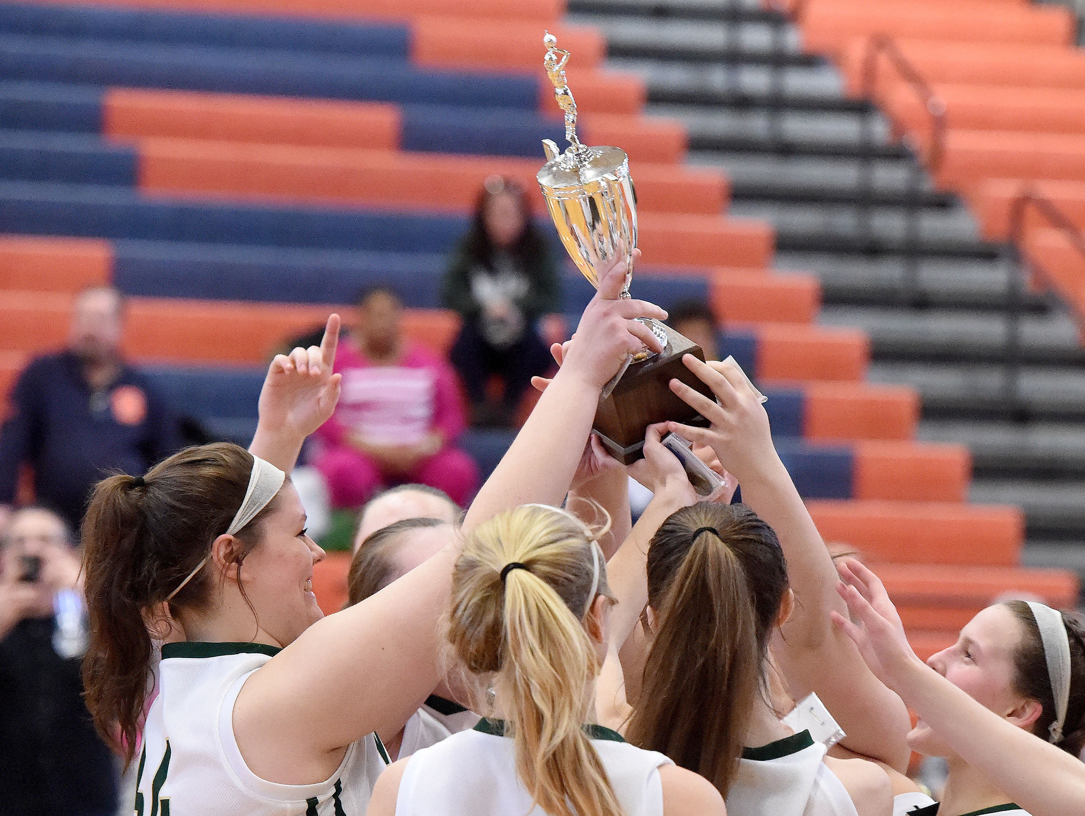 Wilson Memorial players hold up the championship trophy as a team after defeating Buffalo Gap in the Region 2A East girls basketball championship played in Orange on Saturday, Feb. 27, 2016.