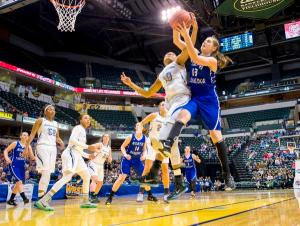 Heritage Christian's Katlyn Gilbert (10) and North Harrison's Carlie Burson (13) vie for a rebound during the first half of the IHSAA girls' Class 3A basketball championship game Saturday, Feb. 27, 2016, in Indianapolis. (AP Photo/Doug McSchooler)