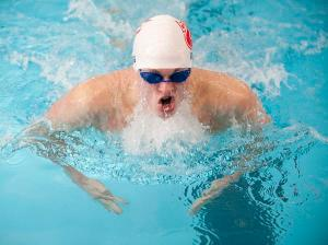 Benjamin Doss of Jeffersonville captures the 100 yard breaststroke with a time of 59:32 seconds. 20 February, 2016