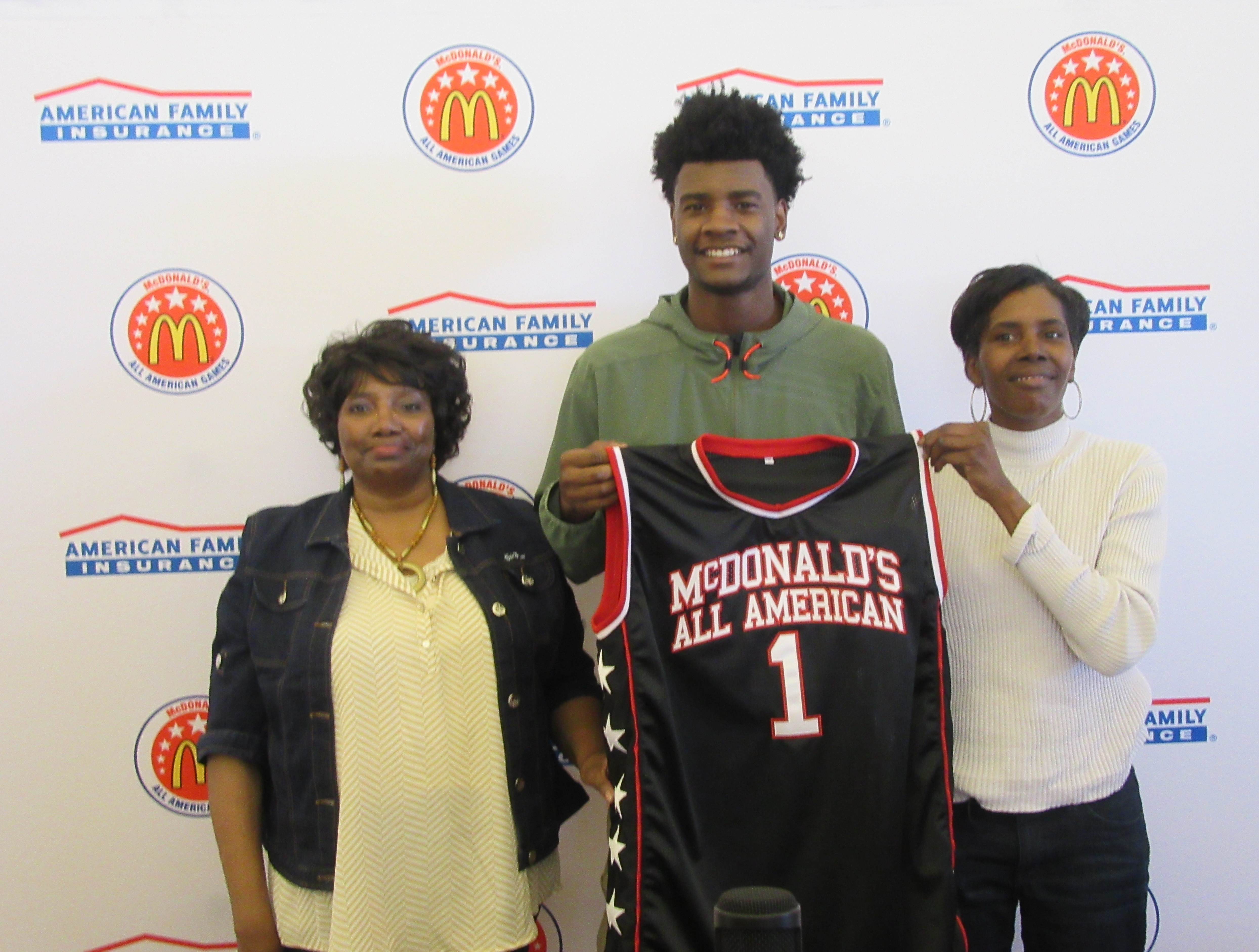 Josh Jackson with his mother and grandmother after he received his honorary McDonald's All American jersey (Photo: McDonald's All American Game)