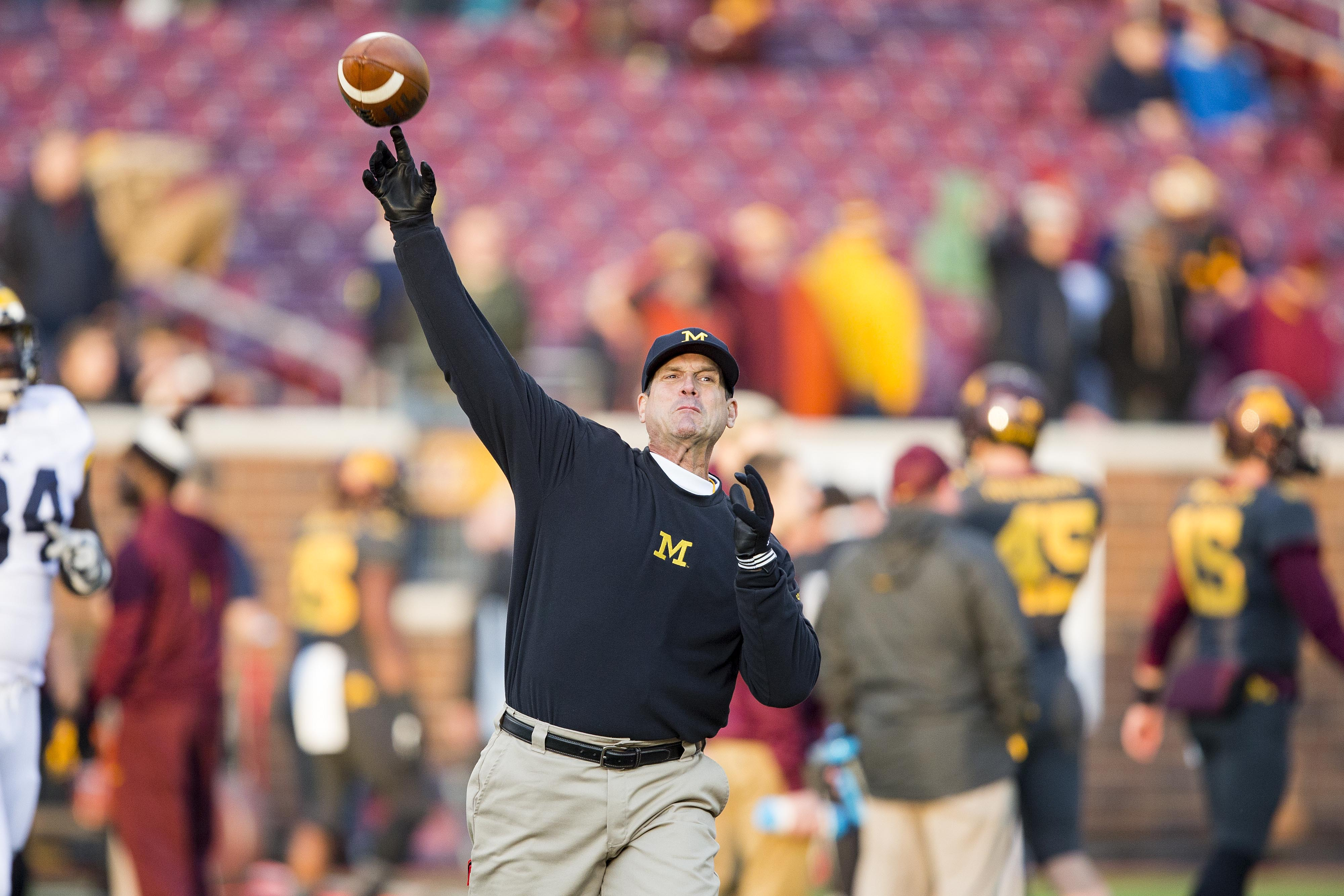 Michigan head coach Jim Harbaugh throws passes during warm ups before a game. (Photo: Jesse Johnson, USA TODAY Sports)