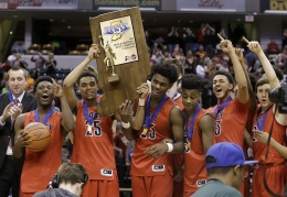 The New Albany Bulldogs celebrates winning the IHSAA 4A Boys Basketball State Final game Saturday, Mar 26, 2016, evening at Bankers Life Fieldhouse. The New Albany Bulldogs defeated the McCutcheon Mavericks 62-59.
