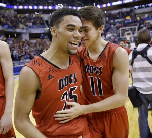 New Albany Bulldogs Josh Jefferson (25) and Peyton Martin (11) celebrate winning the IHSAA 4A Boys Basketball State Final game Saturday, Mar 26, 2016, evening at Bankers Life Fieldhouse. The New Albany Bulldogs defeated the McCutcheon Mavericks 62-59.