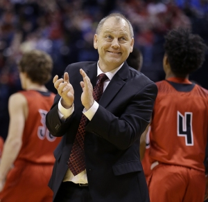 New Albany Bulldogs head coach Jim Shannon applauds his players efforts in the second half of the IHSAA 4A Boys Basketball State Final game Saturday, Mar 26, 2016, evening at Bankers Life Fieldhouse. The New Albany Bulldogs  defeated the McCutcheon Mavericks 62-59.