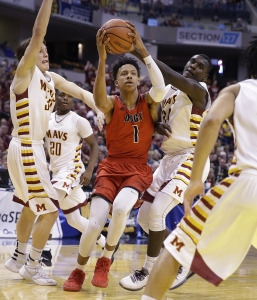 New Albany Bulldogs Romeo Langford (1) is almost triple-teamed but still drives to the backer in the second half of the IHSAA 4A Boys Basketball State Final game Saturday, Mar 26, 2016, evening at Bankers Life Fieldhouse. The New Albany Bulldogs defeated the McCutcheon Mavericks 62-59.