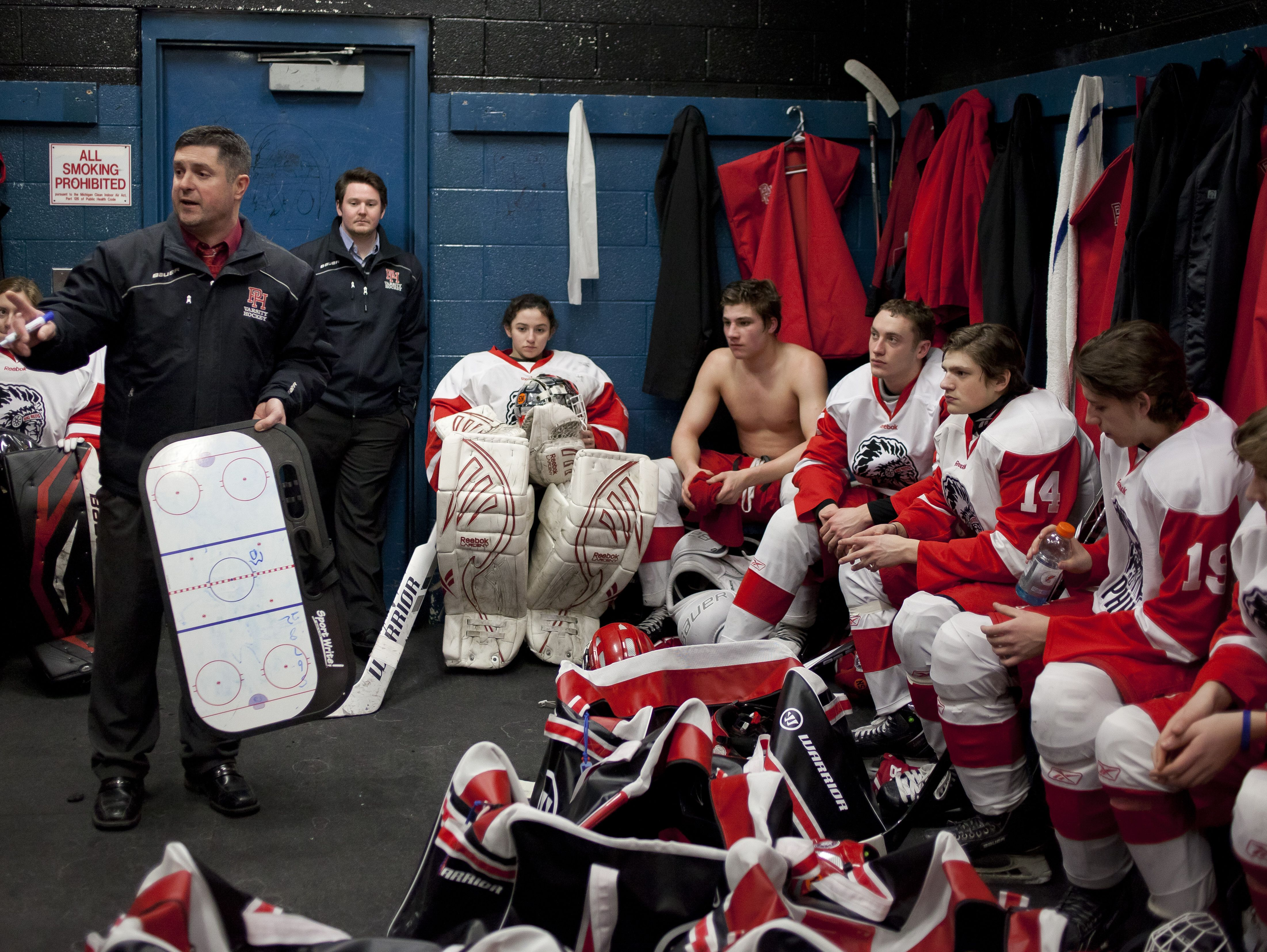 Port Huron coach Ben Pionk talks with players in the locker room during a hockey game Tuesday, March 3, 2015 at McMorran Pavilion.