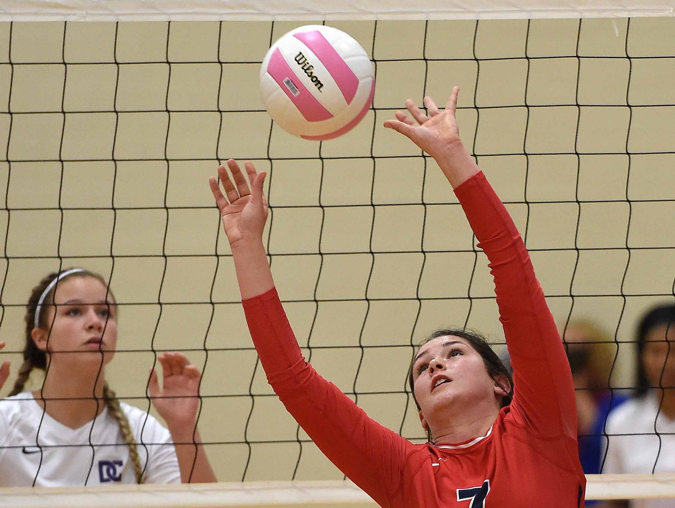 Hancock's Madison Ladner (7) set the ball on Saturday, October 31, 2015, in the MHSAA State Volleyball Championships.