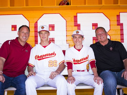 Former major league players Luis Gonzalez, left and Tom Candiotti, right, have sons on the Scottsdale Chaparral High School baseball team. Chaparral third baseman Jacob Gonzalez, center left, and pitcher Casey Candiotti, center right, are seen here with their fathers (Photo: Danny Miller/azcentral sports)