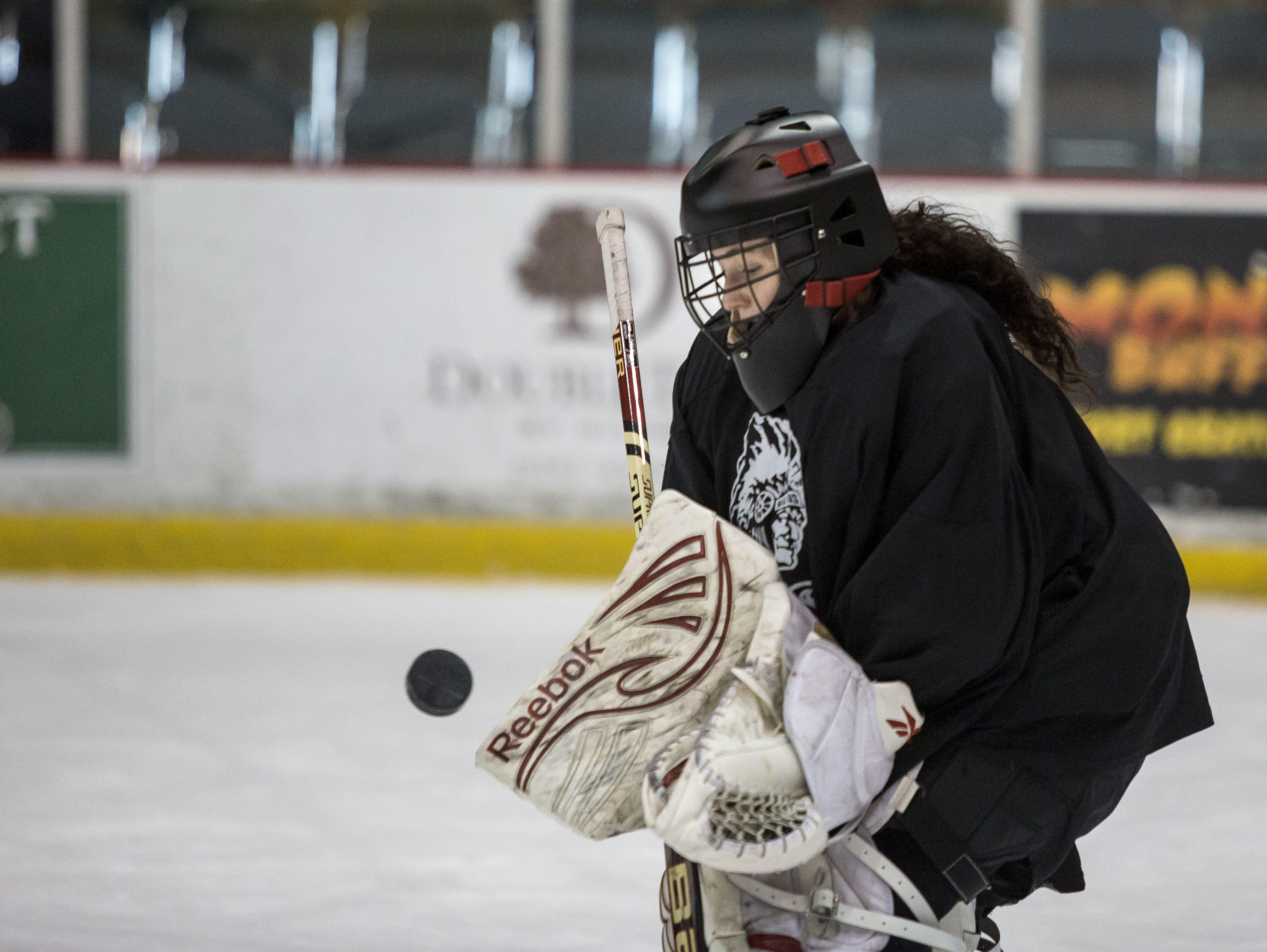 Port Huron goalie Ally Fetterly stops a shot on goal during a practice at McMorran Arena in Port Huron.