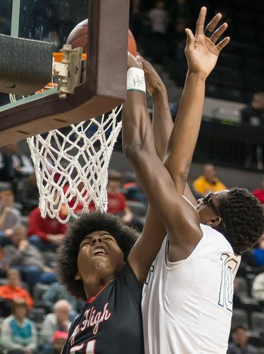 West High senior Wali Parks (10) dunks the ball over City High senior Micah Martin (51) in the first quarter (Photo: Bill Adams, For the Iowa City Press Citizen)