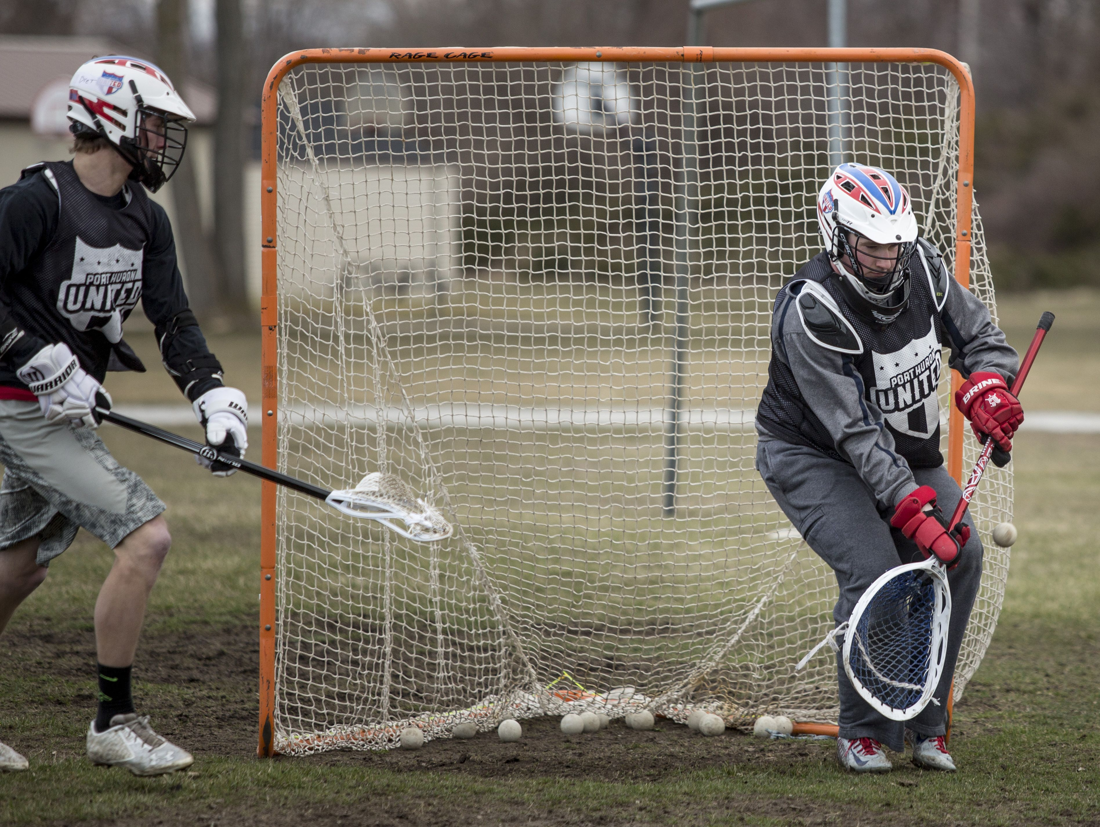 Port Huron Unified senior Shane Sheridan blocks a shot during practice Friday, March 18, 2016 at Central Middle School.
