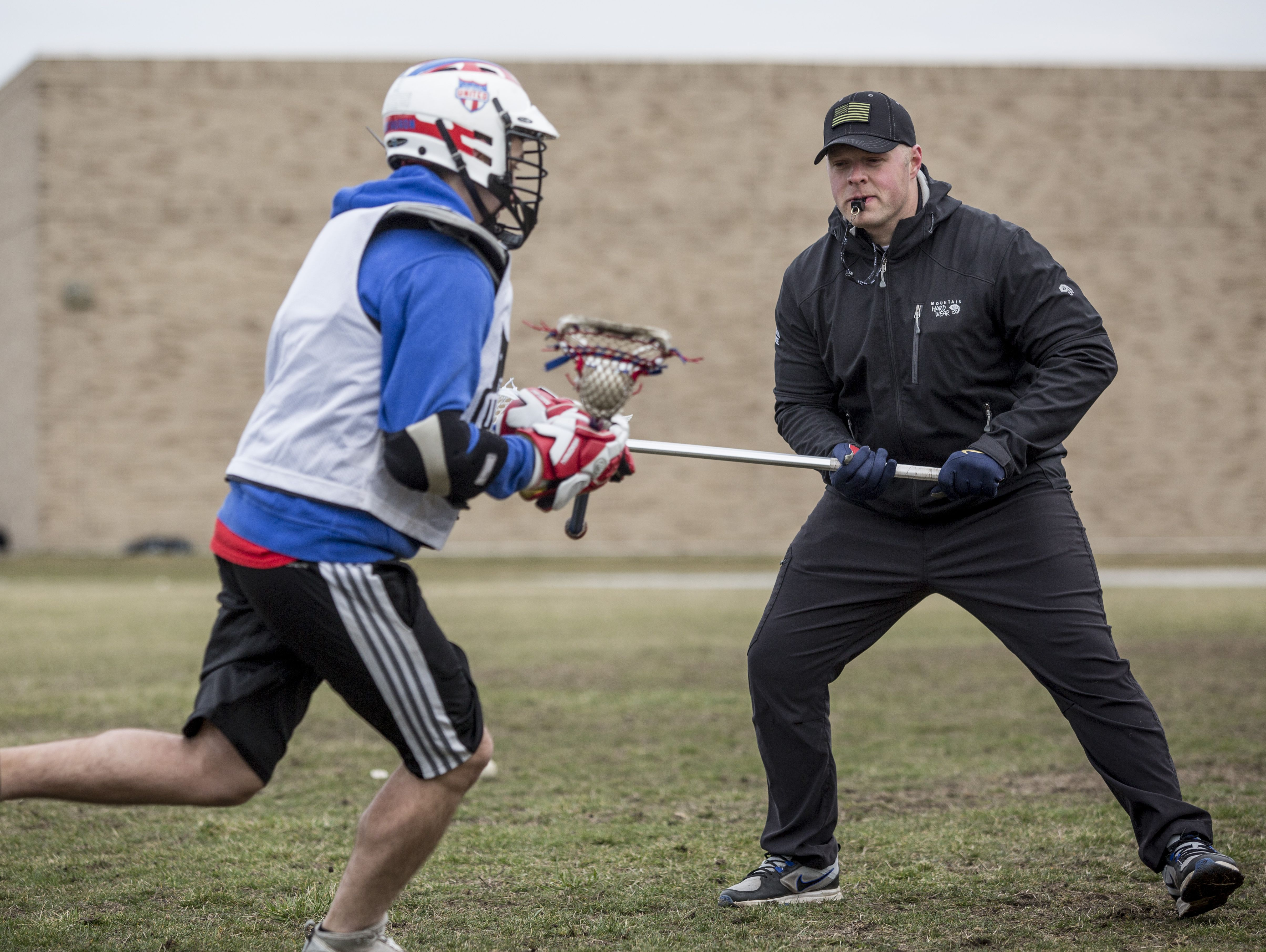 Port Huron Unified coach Jon Holden runs drills with players during practice Friday, March 18, 2016 at Central Middle School.