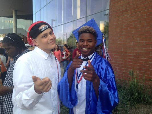 Zach Irelan (left) poses with his brother, Favon, seen in his Independence High graduation gown. (Photo: Courtesy of Marlo Irelan)
