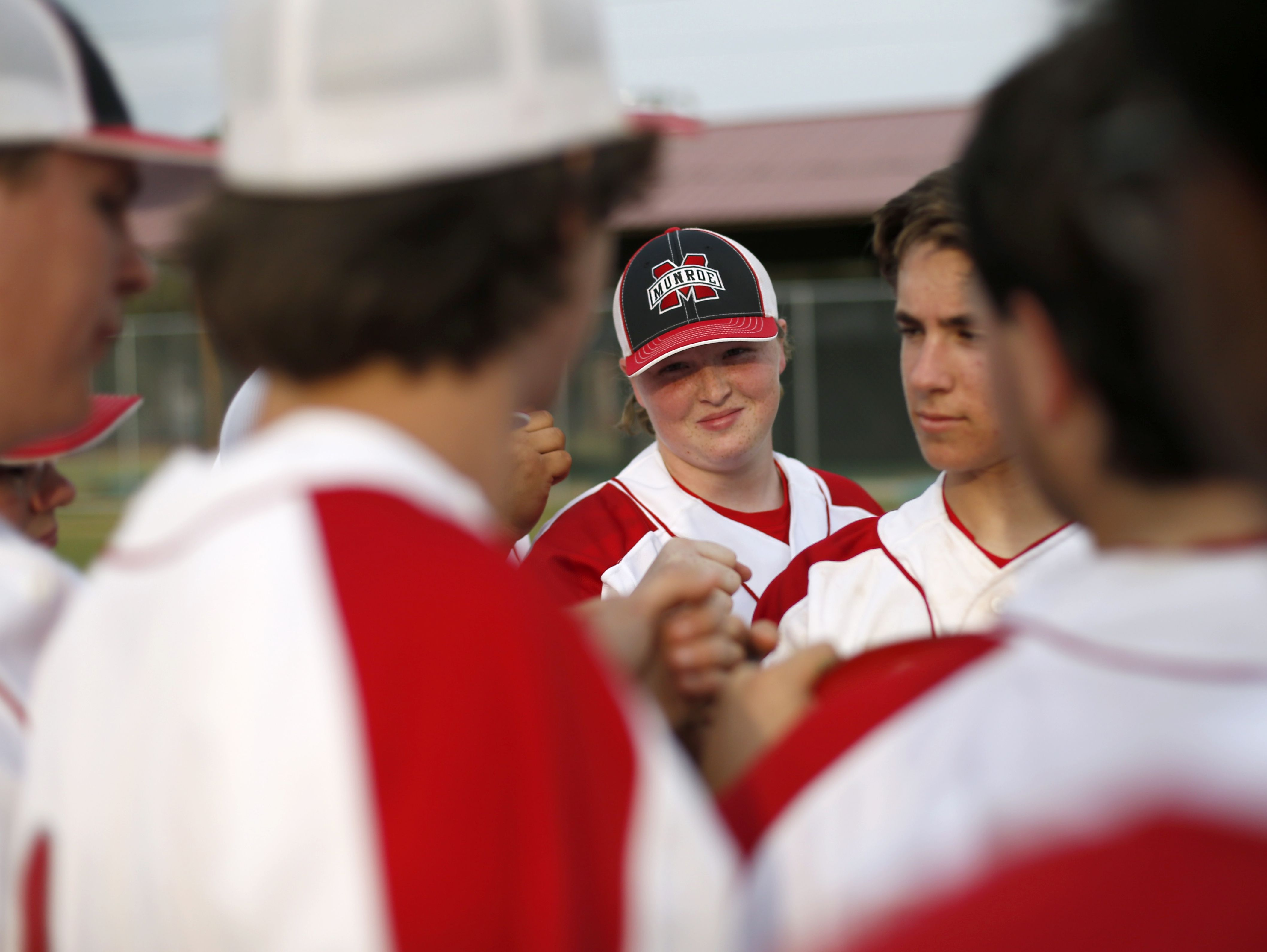 Thomas, center, huddles with her teammates after their game against Rickards last week.