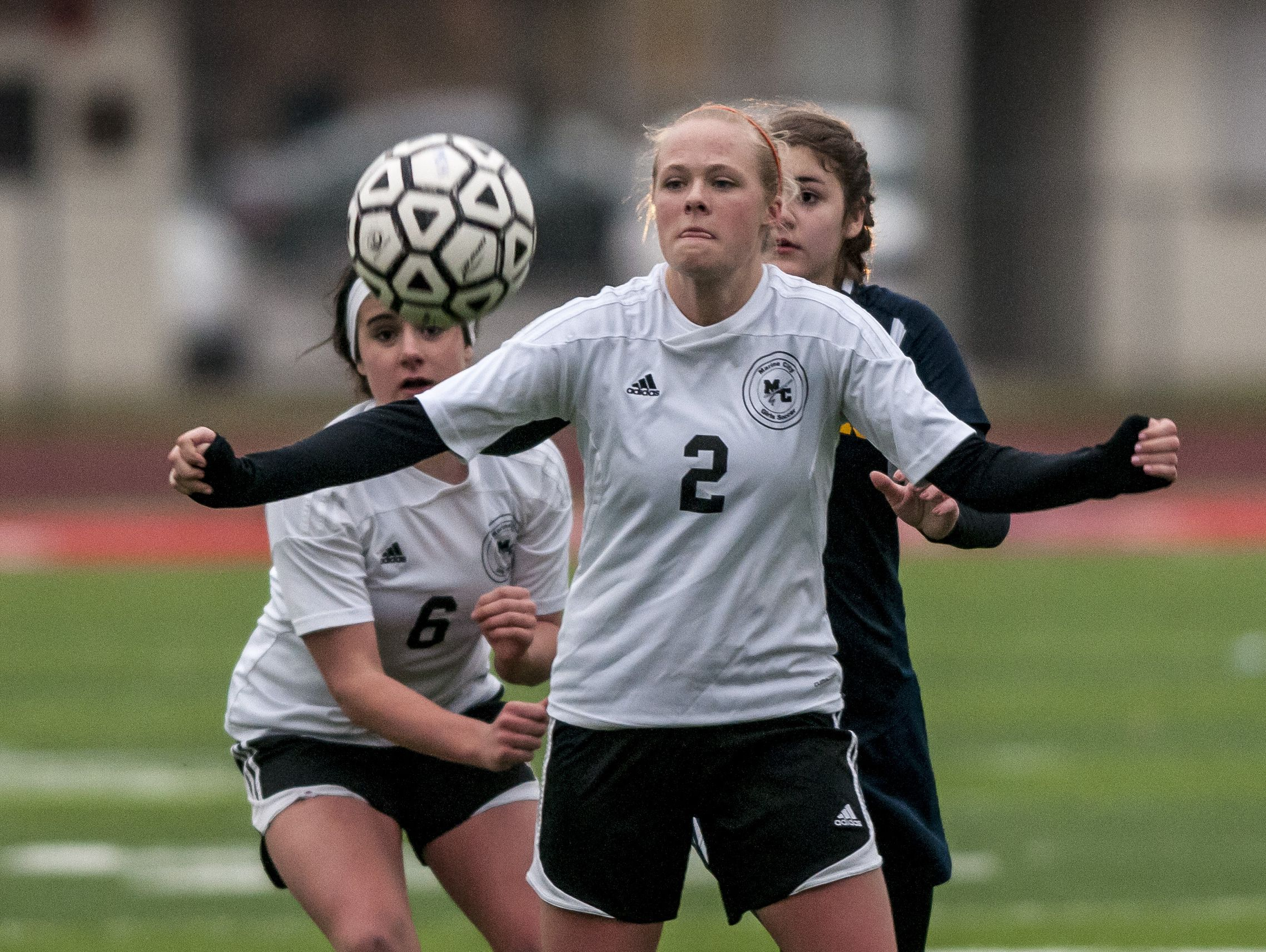 Marine City senior Bailee Gunderson receives a pass during a soccer game Wednesday, March 23, 2016 at East China Stadium.