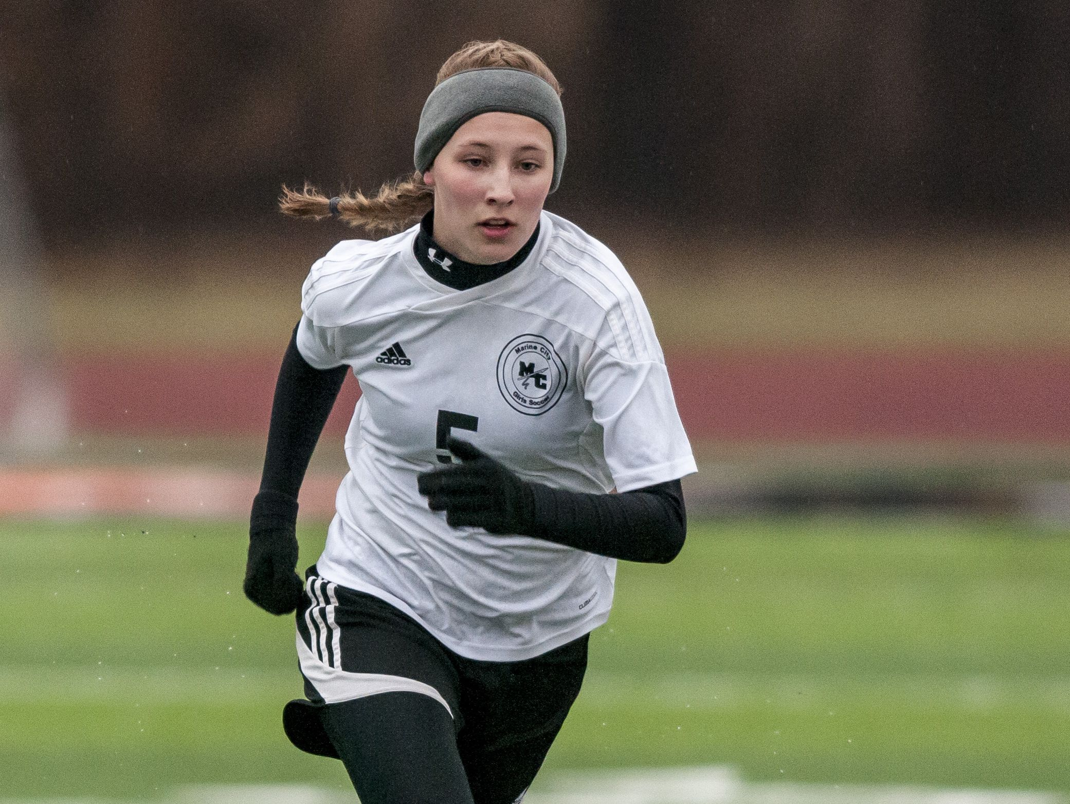 Marine City junior Emilie Andrews attacks the ball during a soccer game Wednesday, March 23, 2016 at East China Stadium.
