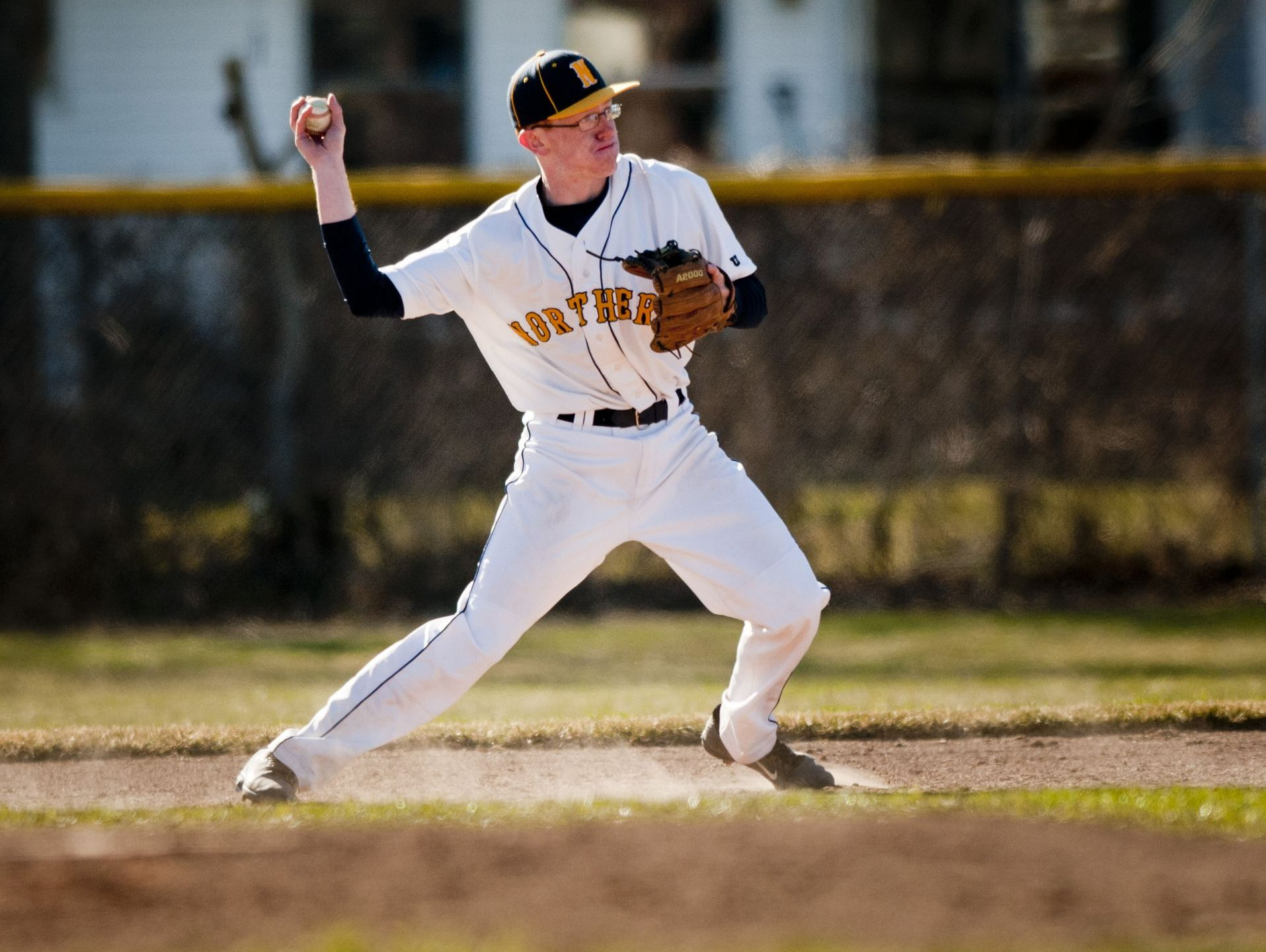 Northern's Isaac Raab throws the ball to second base for the out during a baseball game Wednesday, April 15, 2015 at Port Huron Northern High School.