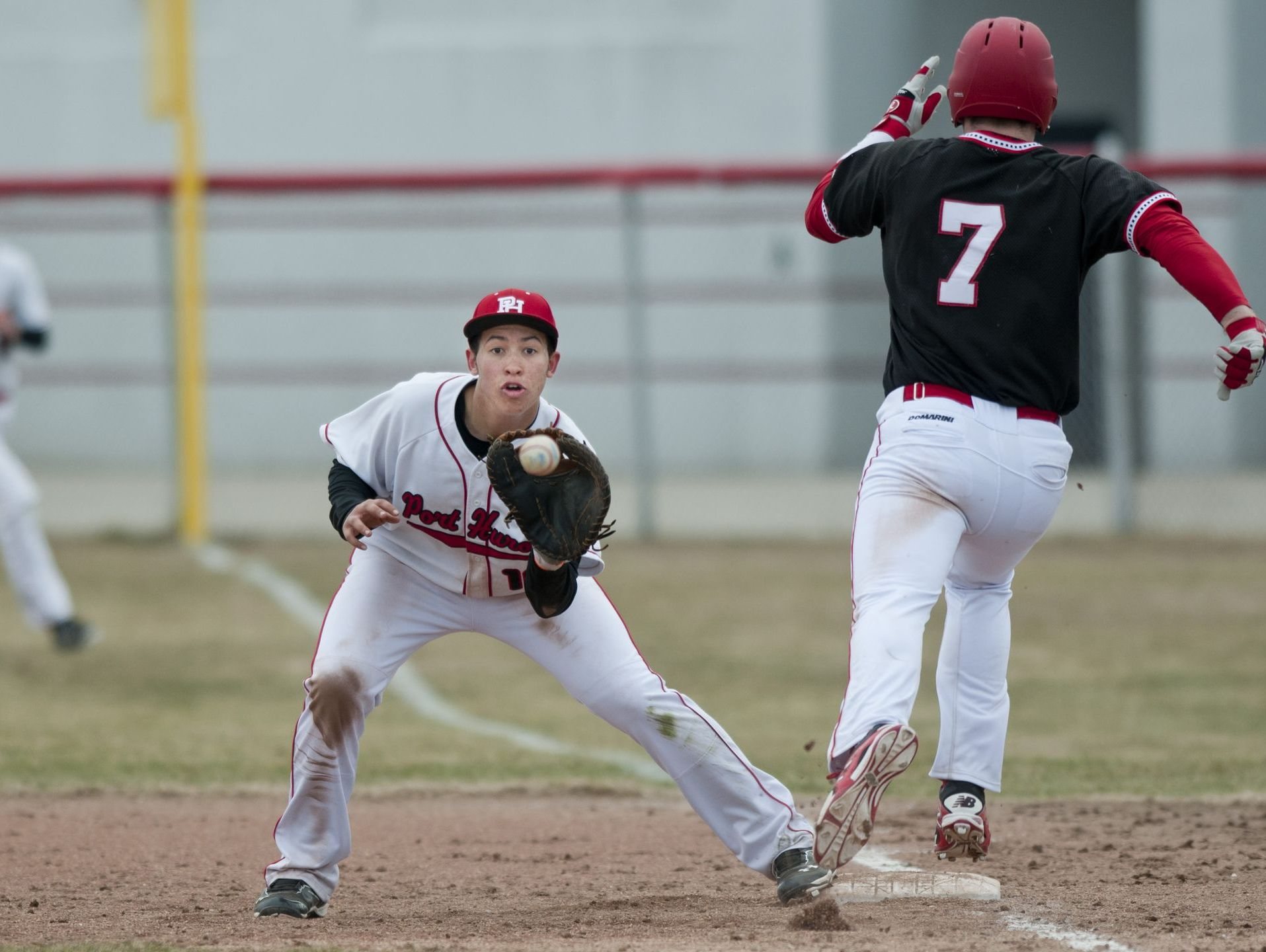 Port Huron's Dallas Mitchell forces out Chippewa Valley's Brendan Murphy at first during a baseball game Tuesday, April 7, 2015 at Port Huron High School.