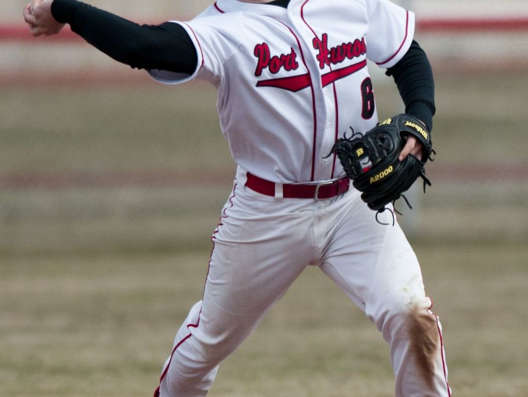 Port Huron's Fred Clark throws the ball to first during a baseball game Tuesday, April 7, 2015 at Port Huron High School.