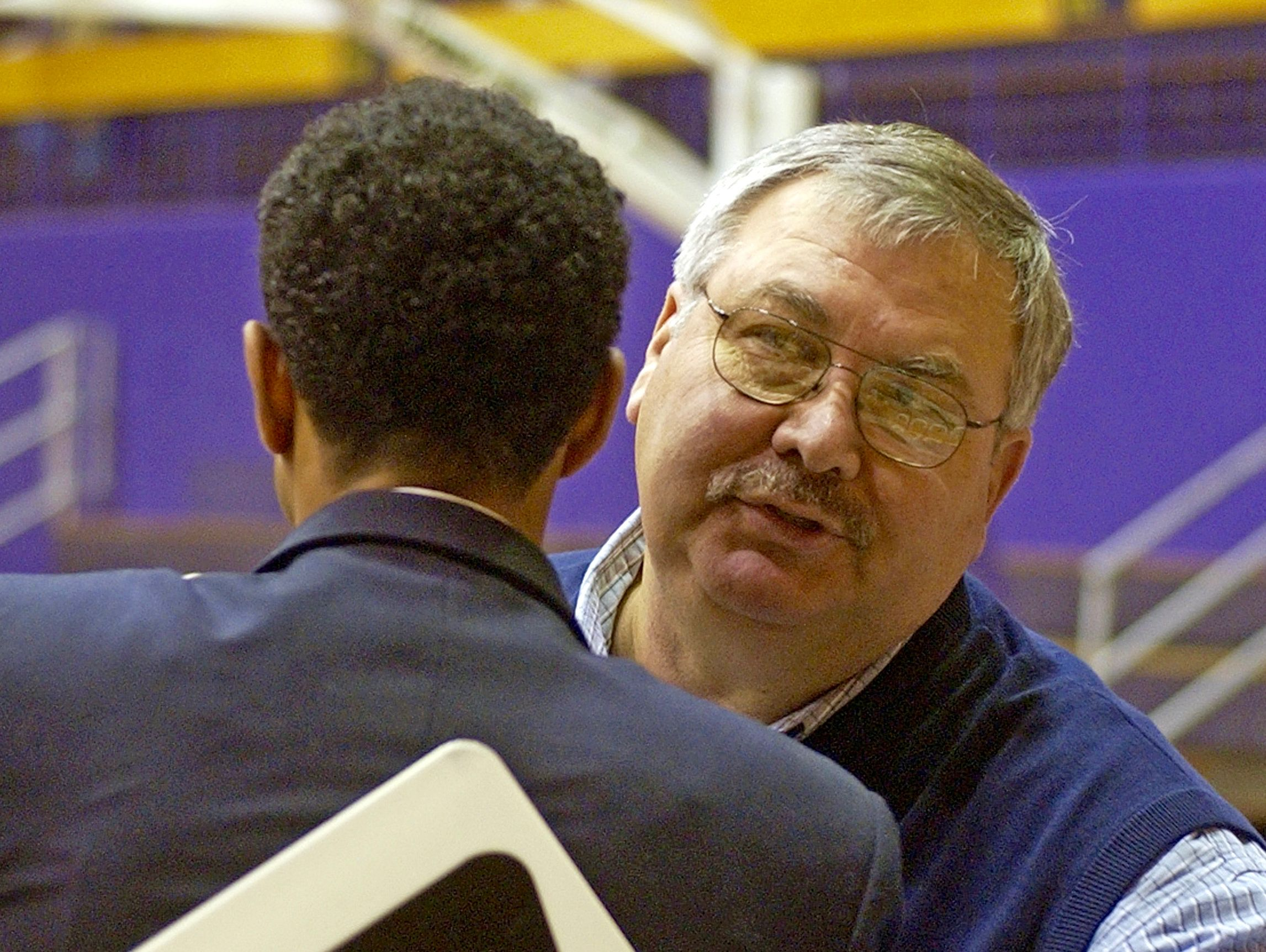 Larry Leonard, assistant women's coach for Charleston Southern, hugs James Madison head coach Kenny Brooks prior to their game in Harrisonburg in 2005. Brooks played for Leonard at Waynesboro High School.
